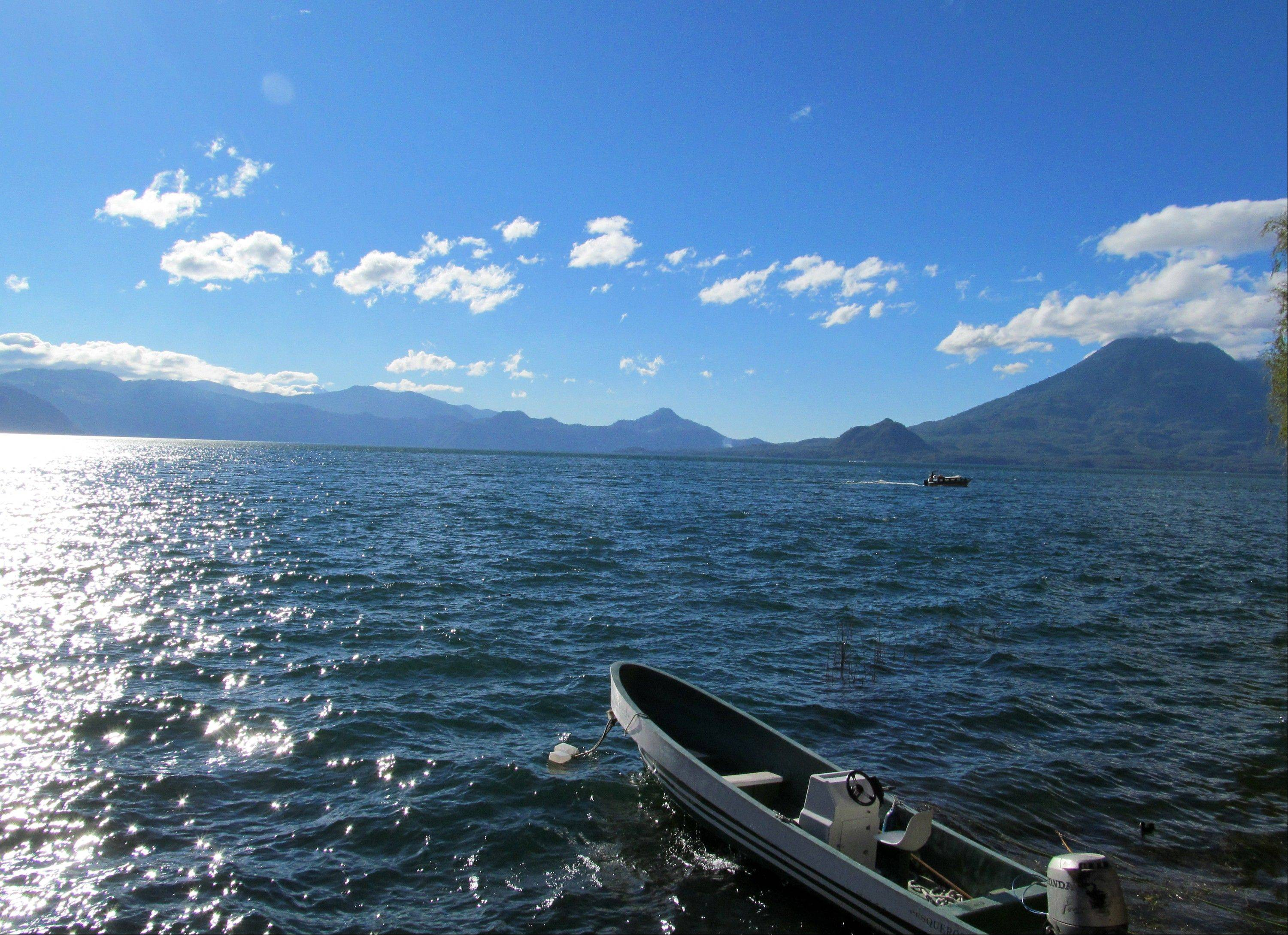 Lake Atitlan, in Guatemala's western highlands, is surrounded by volcanoes Tomilan and Atitlan.