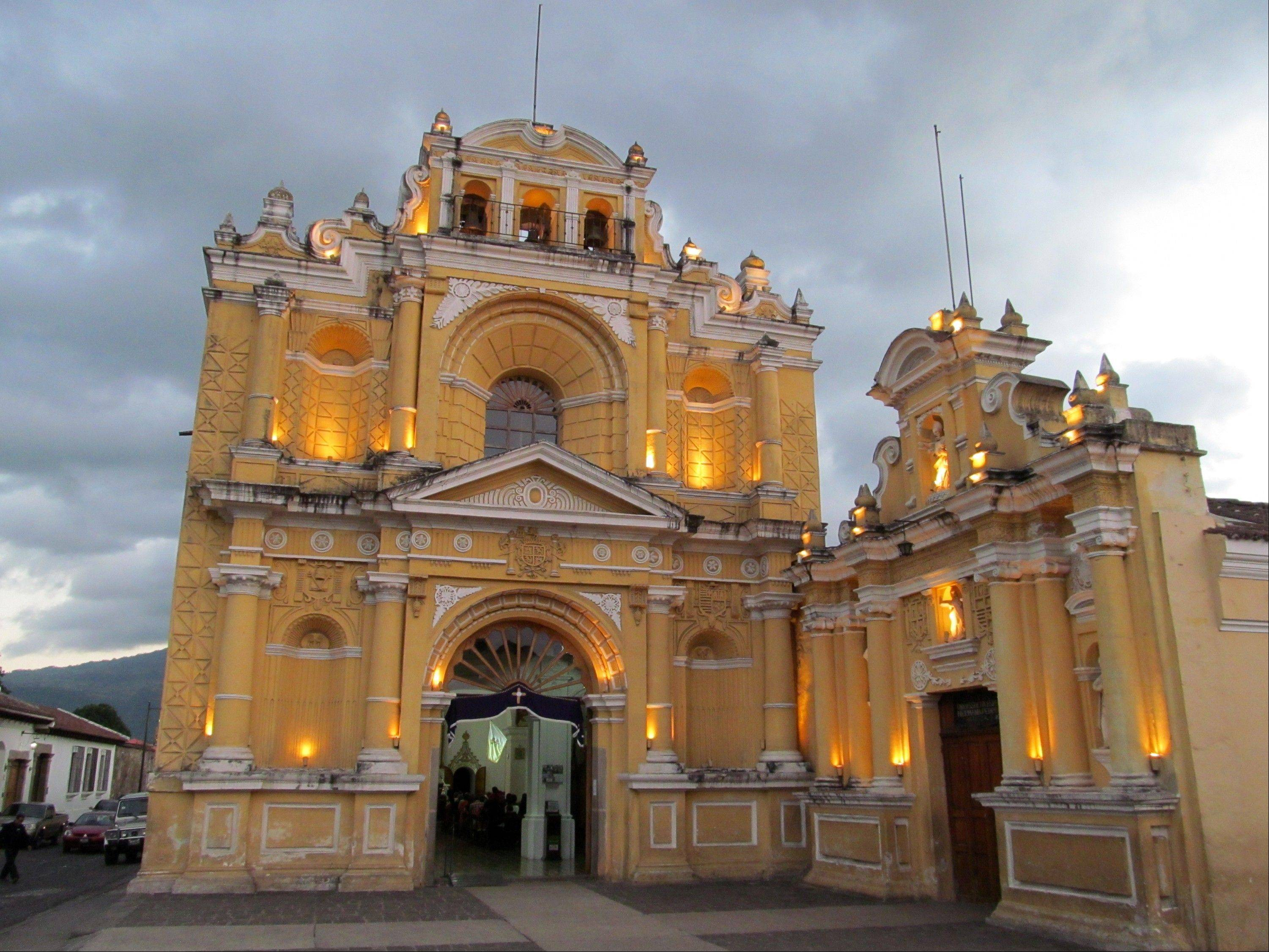 Iglesia de San Pedro, one of the oldest churches in Antigua, Guatemala, is lit up at night. The city boasts one of the best collections of Spanish colonial buildings in the Americas and is a popular destination for tourists.