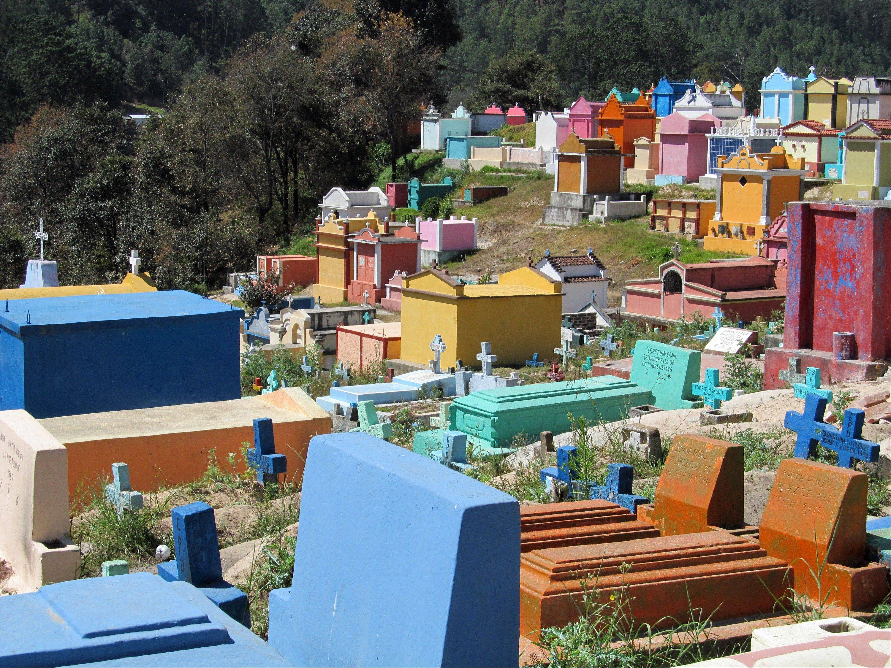 The colorful cemetery in Chichicastenango, Guatemala, where graves carry symbols of the Mayan and Catholic faiths.