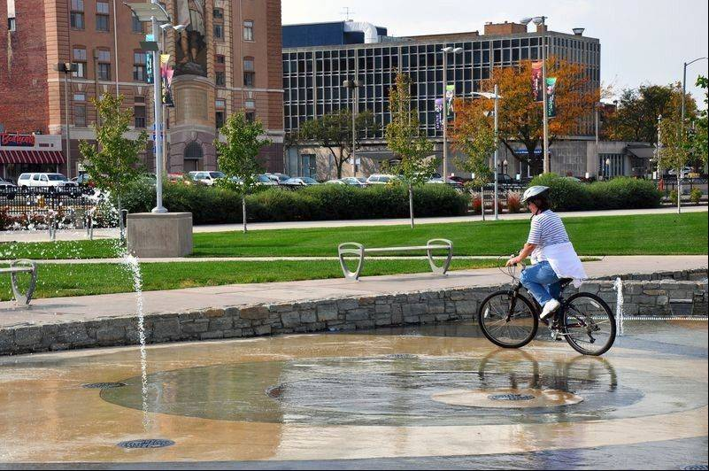 Fountains at Schwiebert Riverfront Park bring out the kid in bicyclists passing on the adjacent bike trail.