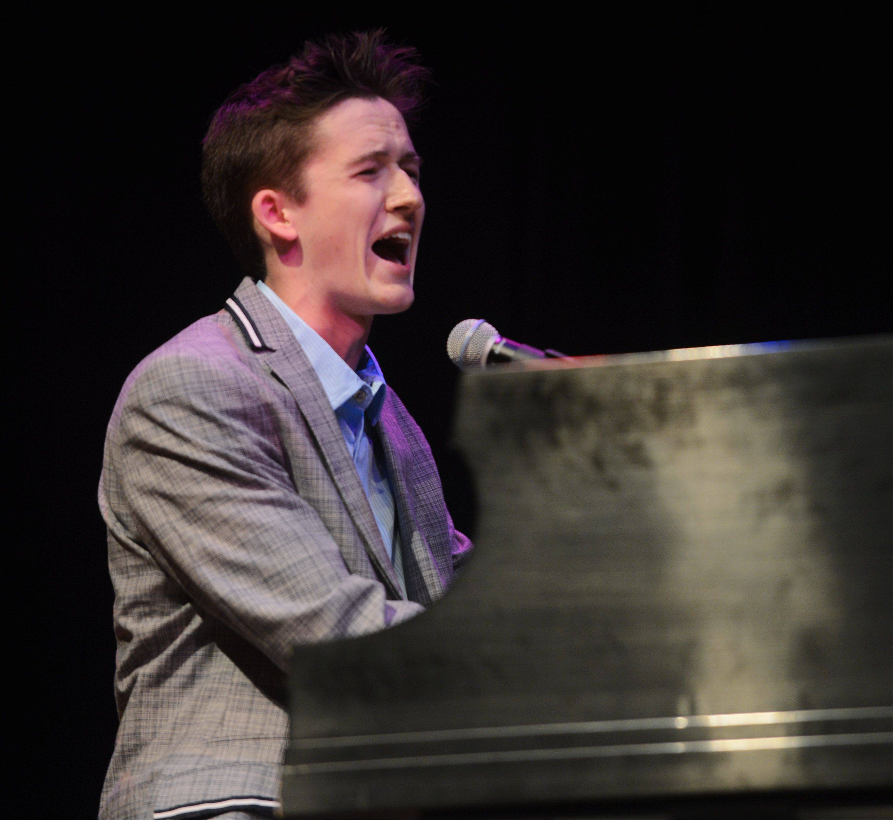 Riley Mangan sings and plays piano as the top 10 finalists of Suburban Chicago's Got Talent perform at the Metropolis Performing Arts Centre in Arlington Heights Sunday.
