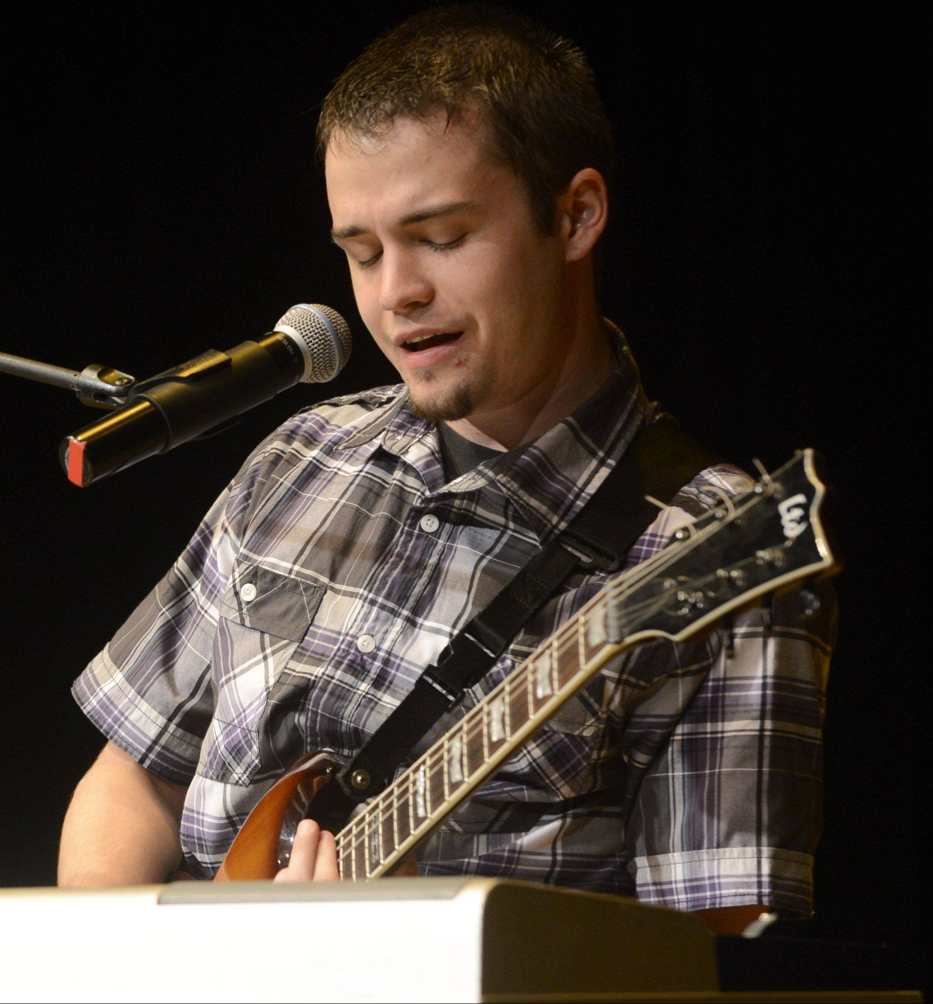 Ryan Cooper sings and plays as the top 10 finalists of Suburban Chicago's Got Talent perform at the Metropolis Performing Arts Centre in Arlington Heights Sunday.