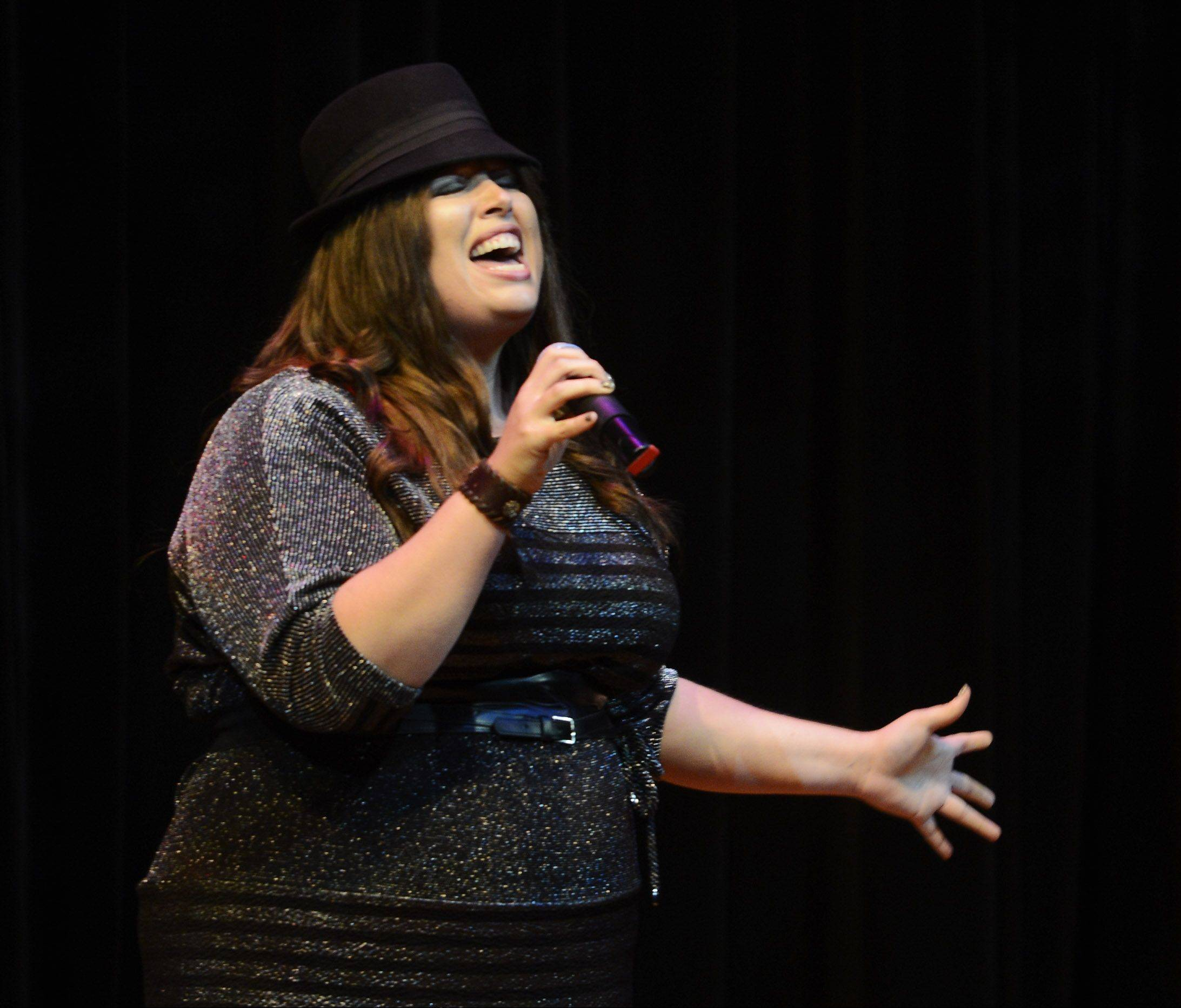 Kimberly Church sings as the top 10 finalists of Suburban Chicago's Got Talent perform at the Metropolis Performing Arts Centre in Arlington Heights Sunday.