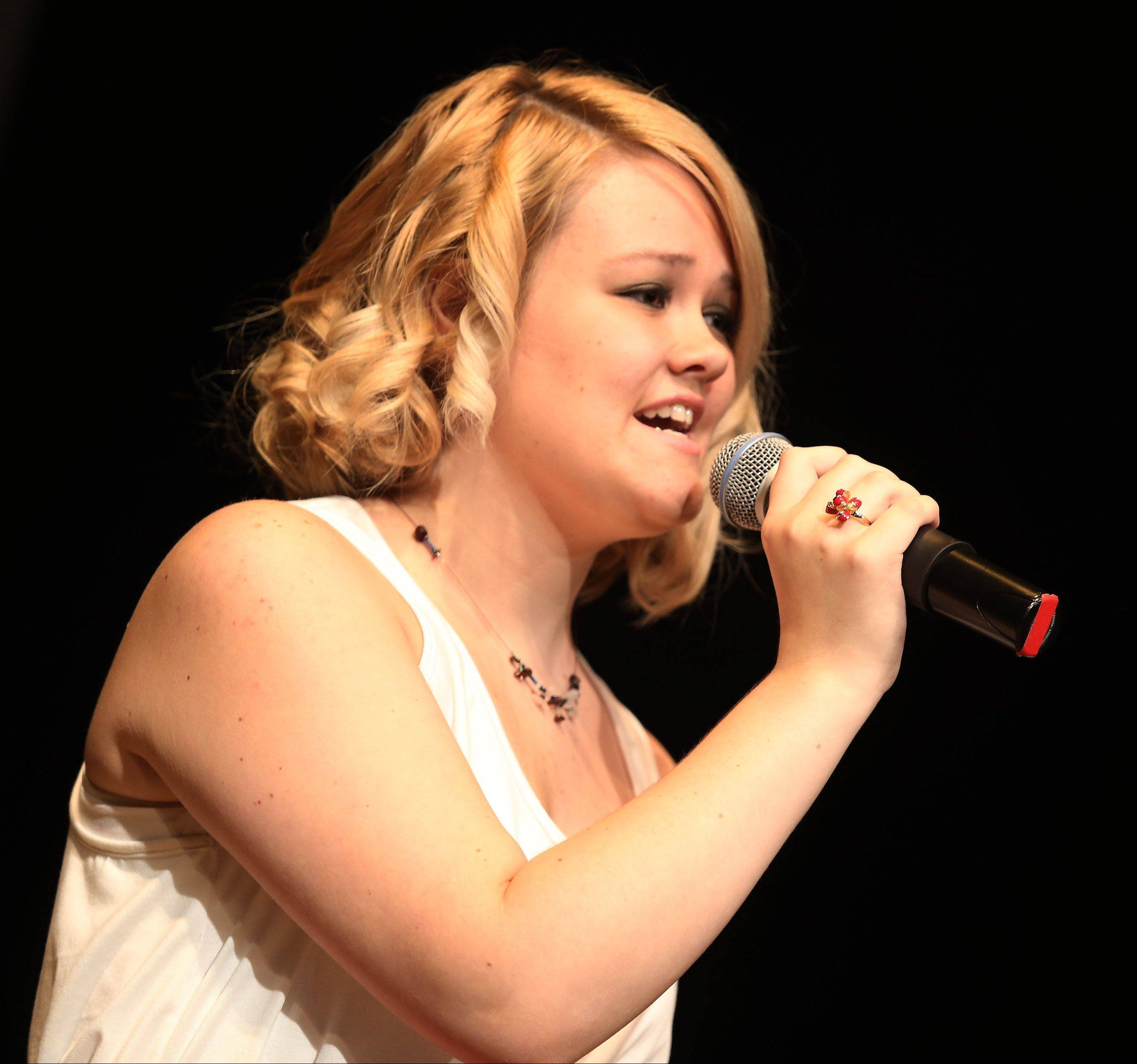 San Sanberg sings as the top 10 finalists of Suburban Chicago's Got Talent perform at the Metropolis Performing Arts Centre in Arlington Heights Sunday.