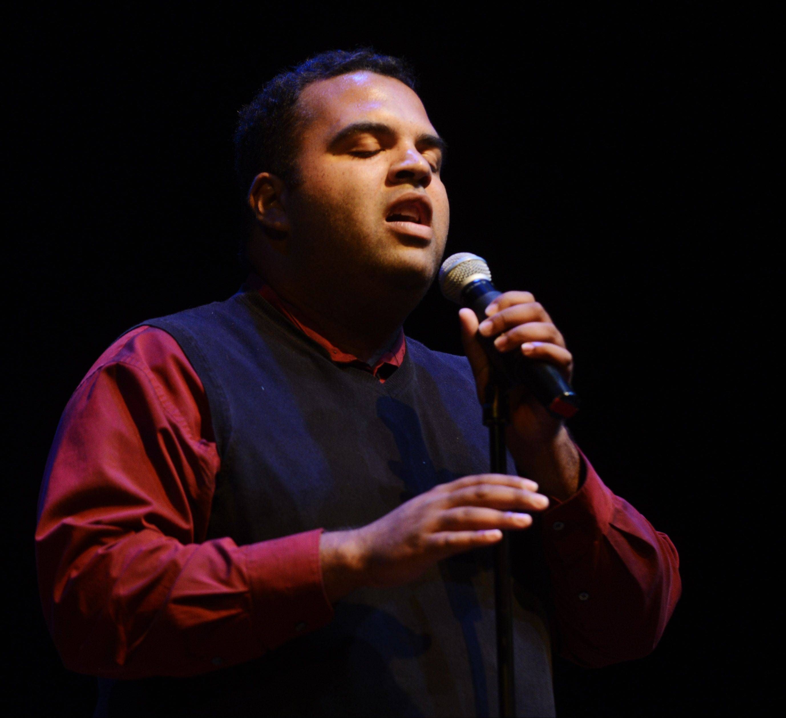 Andrew Johnston sings as the top 10 finalists of Suburban Chicago's Got Talent perform at the Metropolis Performing Arts Centre in Arlington Heights Sunday.