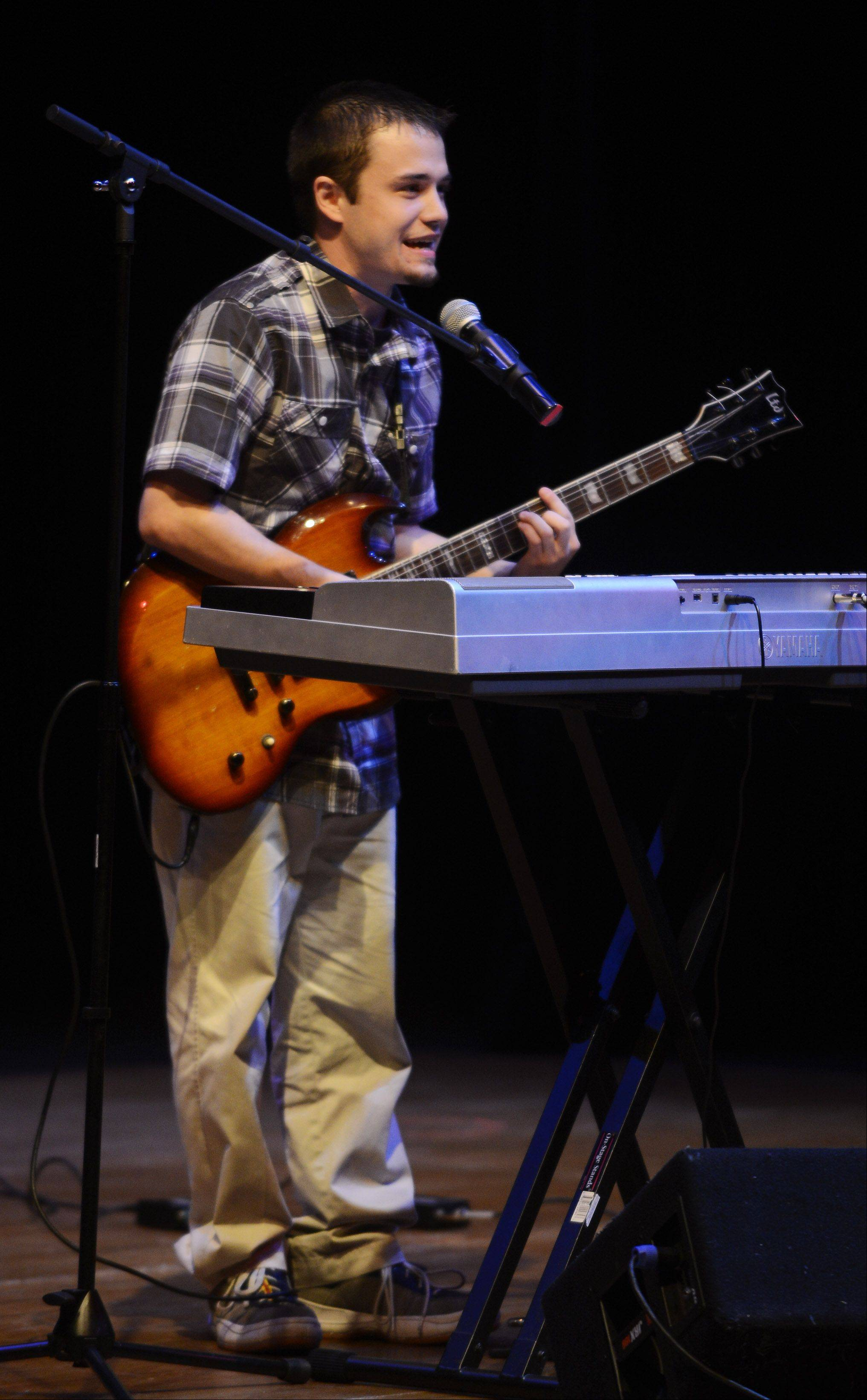Ryan Cooper sings, plays guitar and piano as the top 10 finalists of Suburban Chicago's Got Talent perform at the Metropolis Performing Arts Centre in Arlington Heights Sunday.