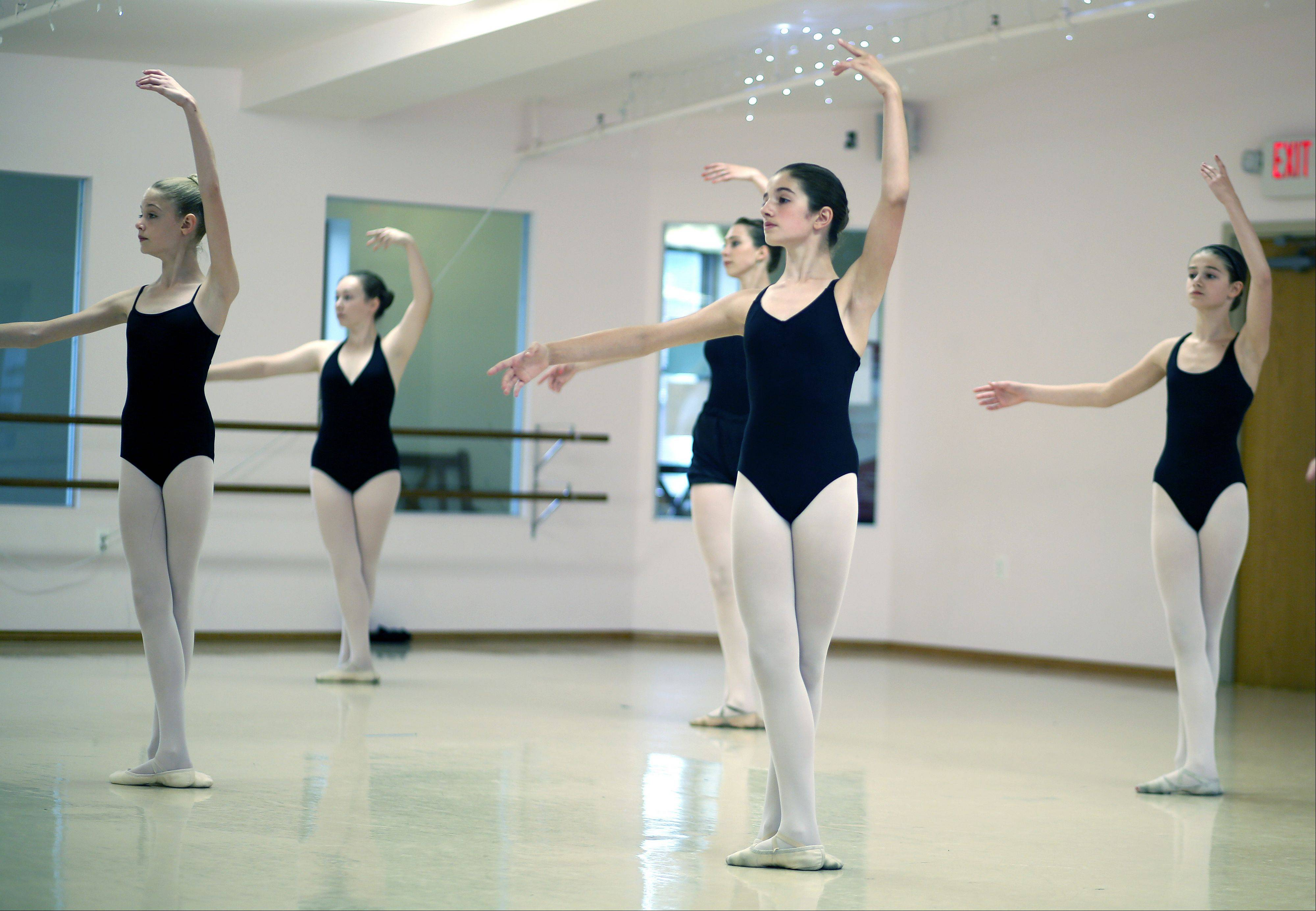 Eleven-year-old Emma Sidari, center, of St. Charles will be attending an internship at Bolshoi Brasil this summer to study ballet.