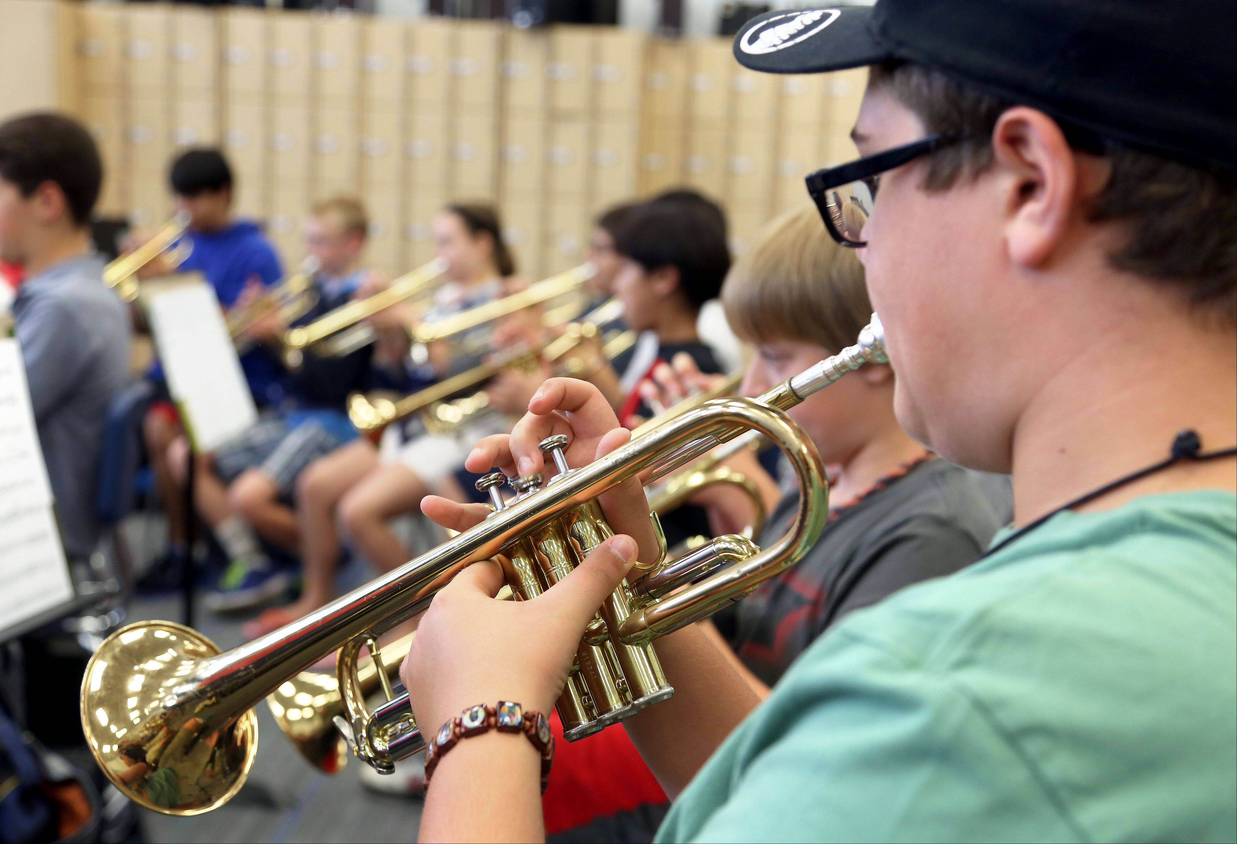 12-year-old Stevan Pastar of Vernon Hills plays his trumpet during Band and Orchestra Camp at Hawthorn Middle School South Monday.