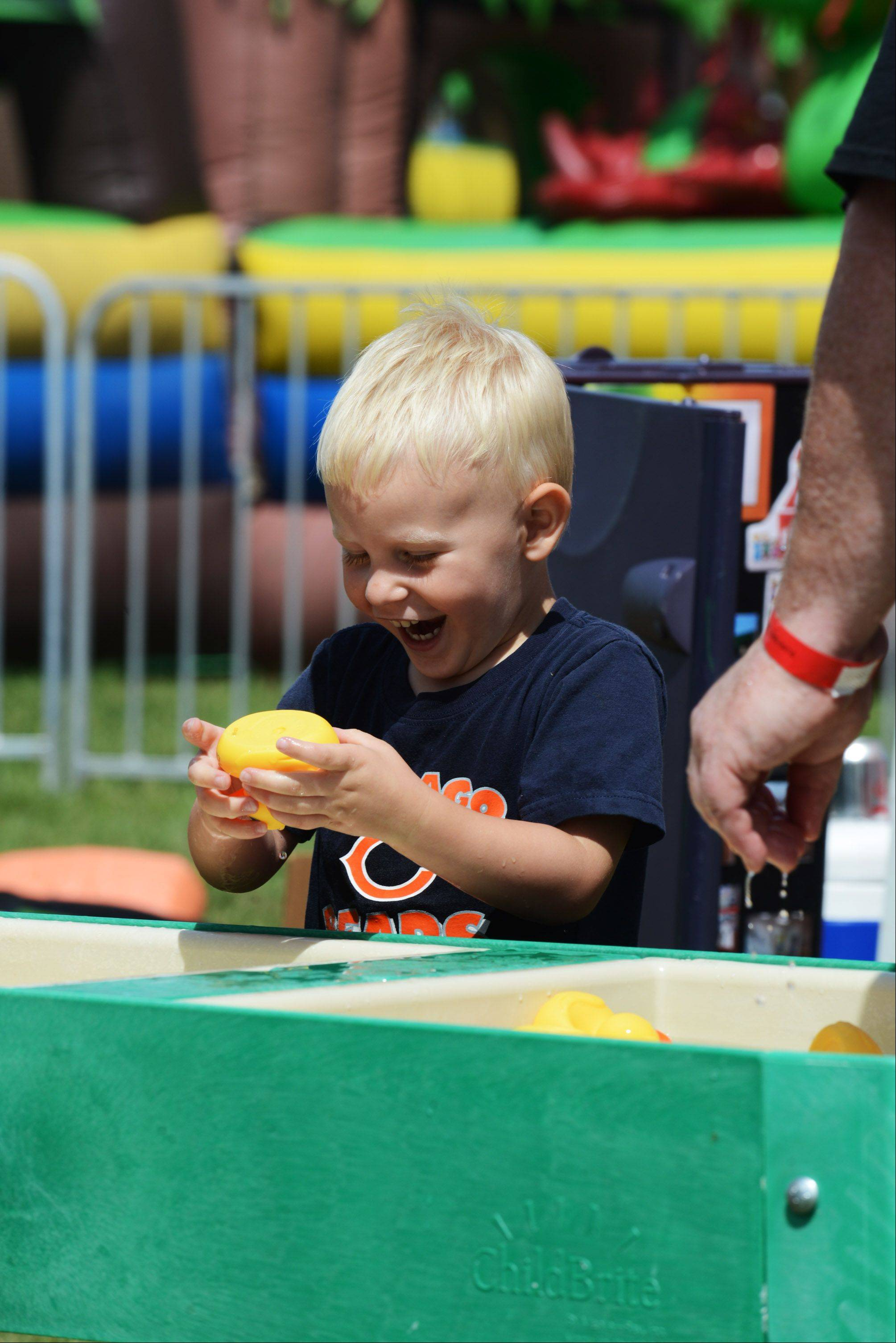 Maddux Rueff, 3, of Woodstock gets pretty excited about a rubber duck at the Safari Childcare booth at the McHenry County Fair on Saturday, August 3 in Woodstock.