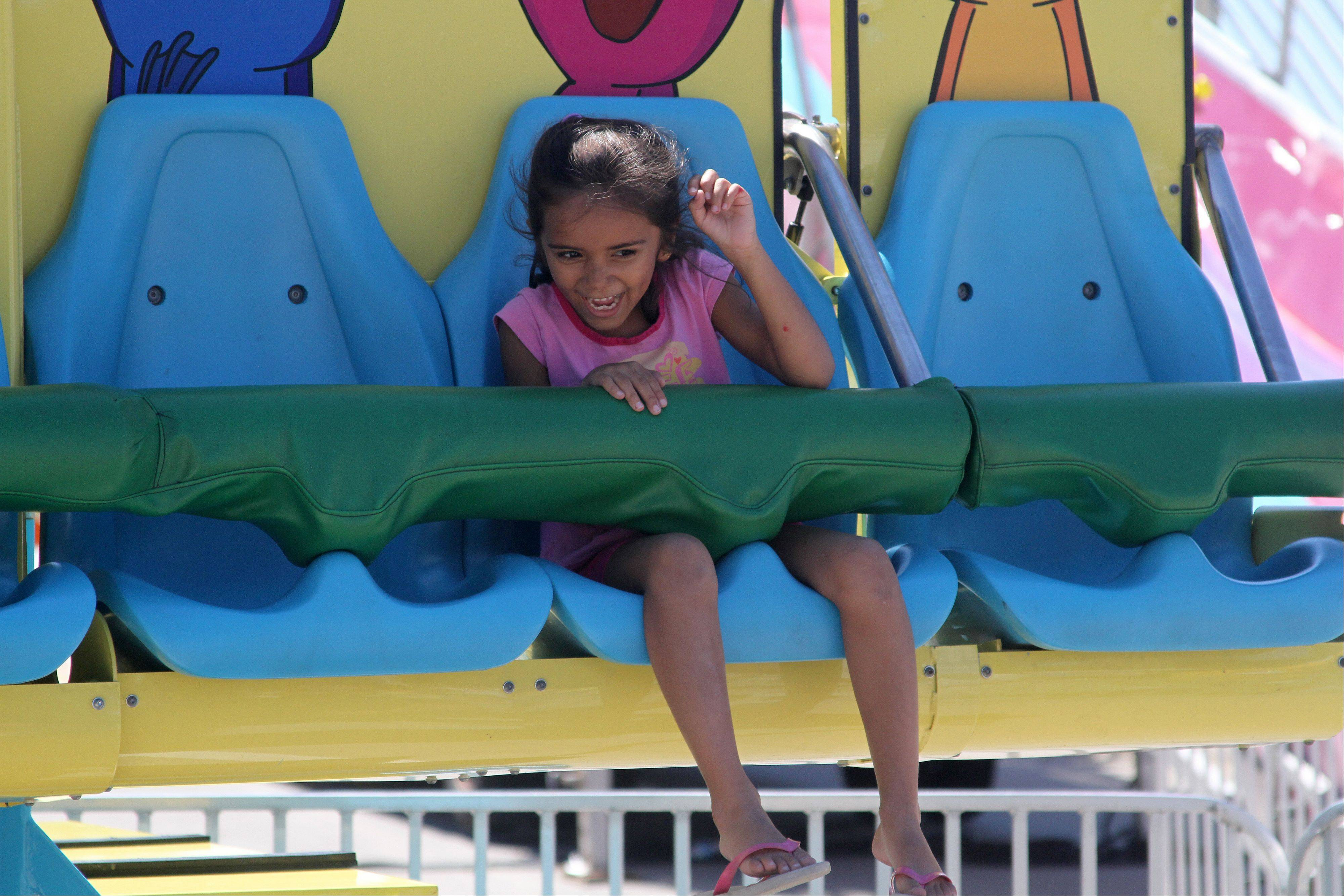 Bhakti Patel, 6, of Roselle rides the frog jump drop kiddie ride at the 2013 Taste of Roselle on Saturday, August 3, 2013. The three-day festival opened Friday and ends Sunday.