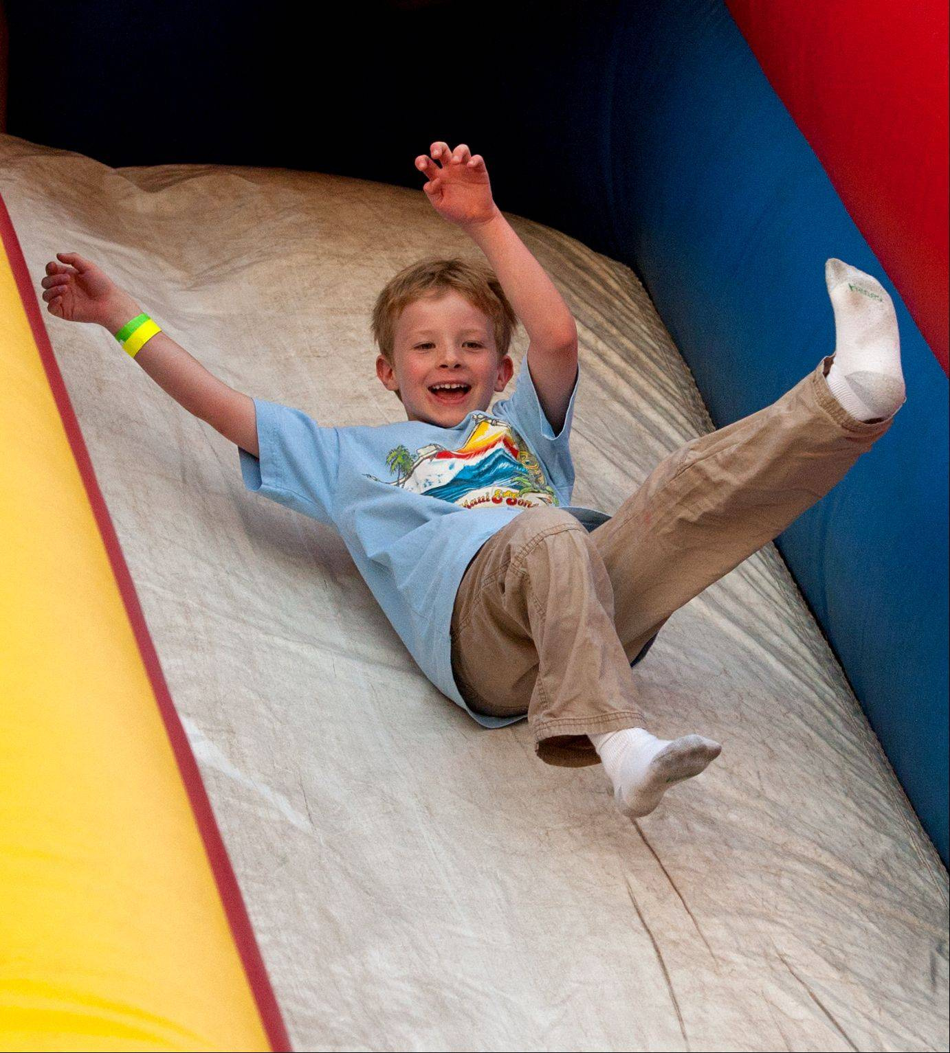 Ben Warren, 6, of Warrenville enjoys his slide during the Warrenville Summer Daze festival.