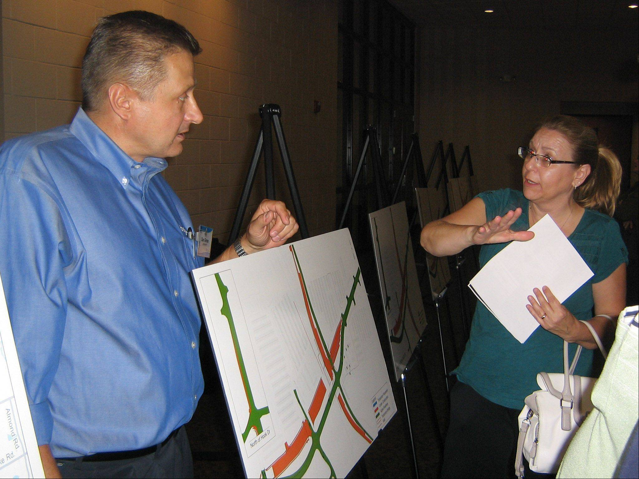 Daniel Gross, left, senior vice president and construction services manager for Alfred Benesch & Co., the firm overseeing the Rollins Gateway project for the Lake County Division of Transportation, explains the plans to Wanda Pucci of Round Lake Beach during an open house.
