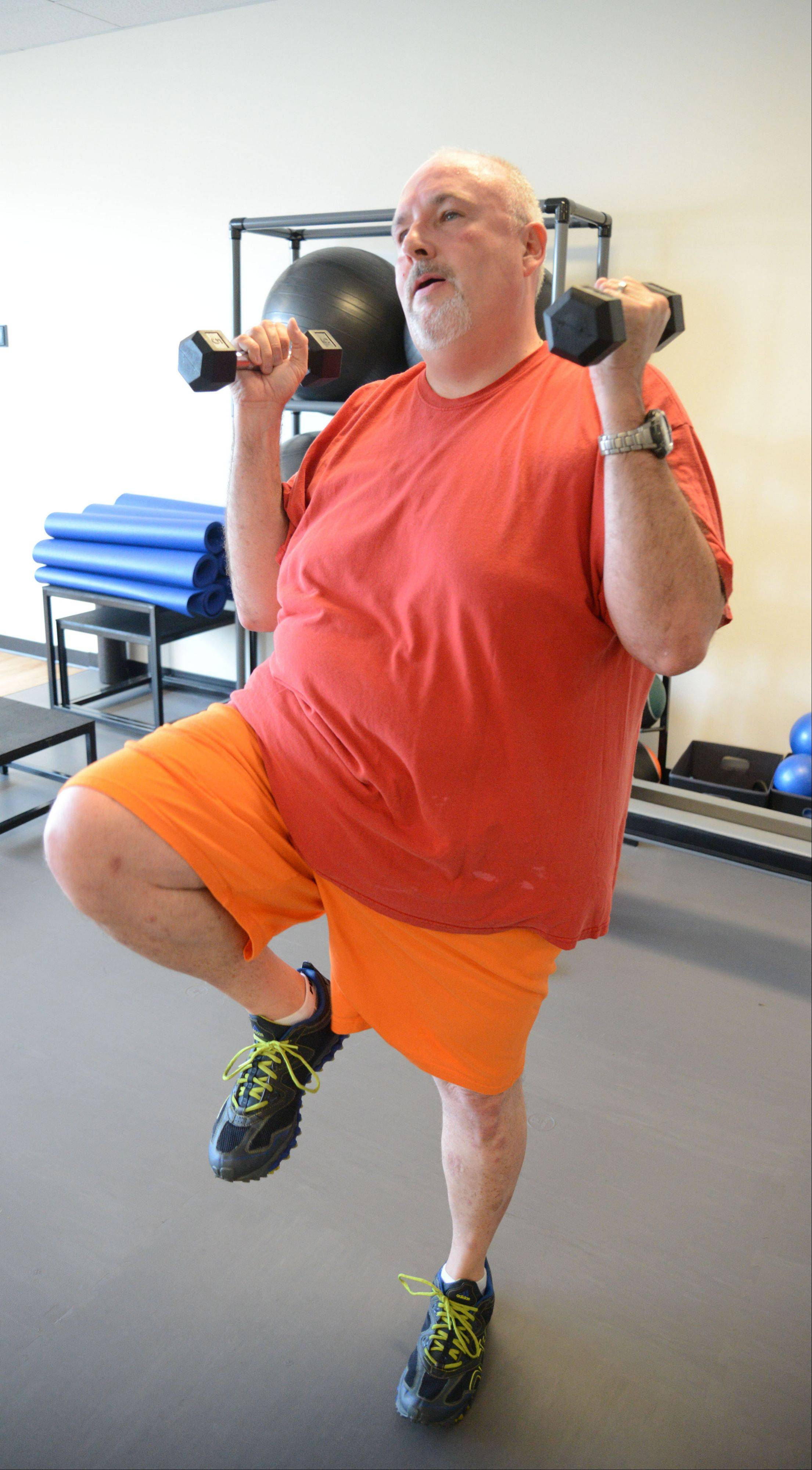 Thomas Callahan participates in a workout class at Downsize Fitness in Naperville. He is one of three male clients so far at the chain's first suburban location, which opened July 1.