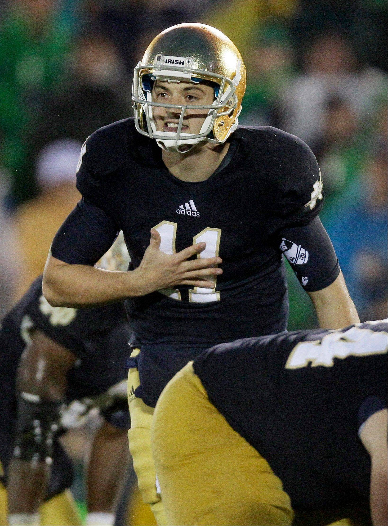 Notre Dame quarterback Tommy Rees talks to teammates during overtime against Stanford on Oct. 13 in South Bend, Ind.