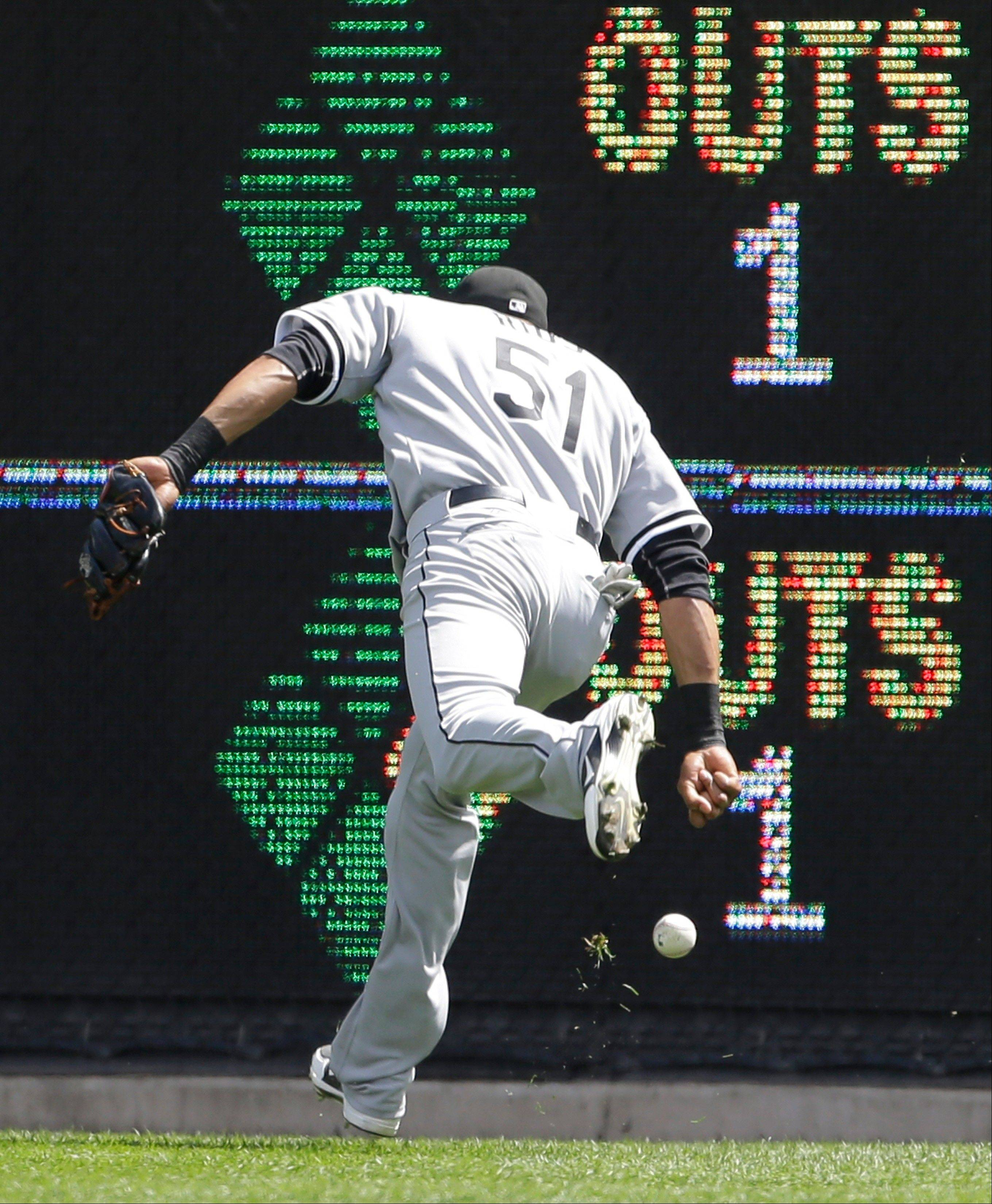White Sox right fielder Alex Rios chases a ball hit for an RBI double by Detroit Tigers' Alex Avila during the seventh inning Sunday in Detroit.