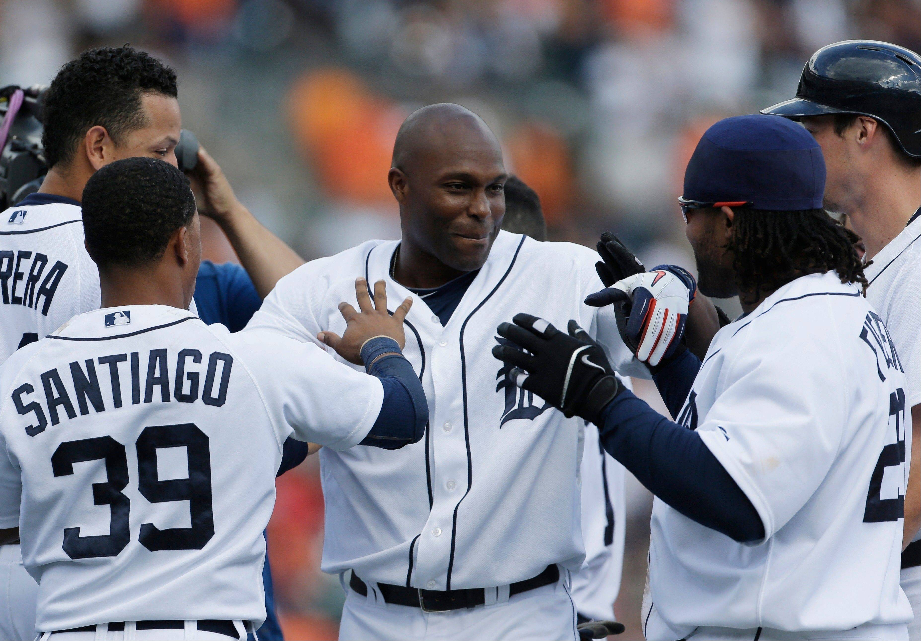 The Tigers' Torii Hunter is mobbed after hitting the game-winning single in the 12th inning Sunday at home against the Chicago White Sox.