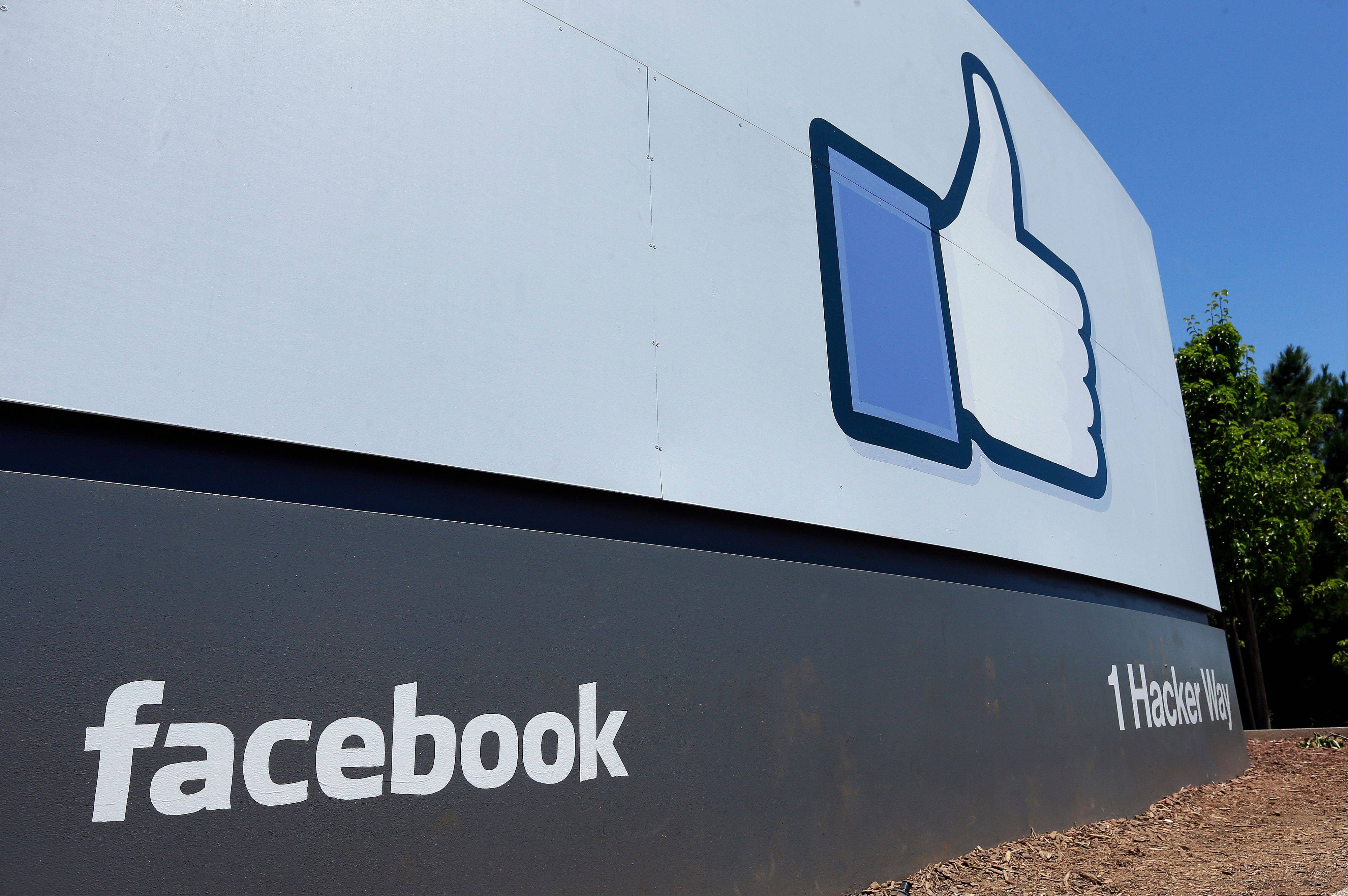 This Tuesday, July 16, 2013, photo, shows a sign seen at Facebook headquarters in Menlo Park, Calif.