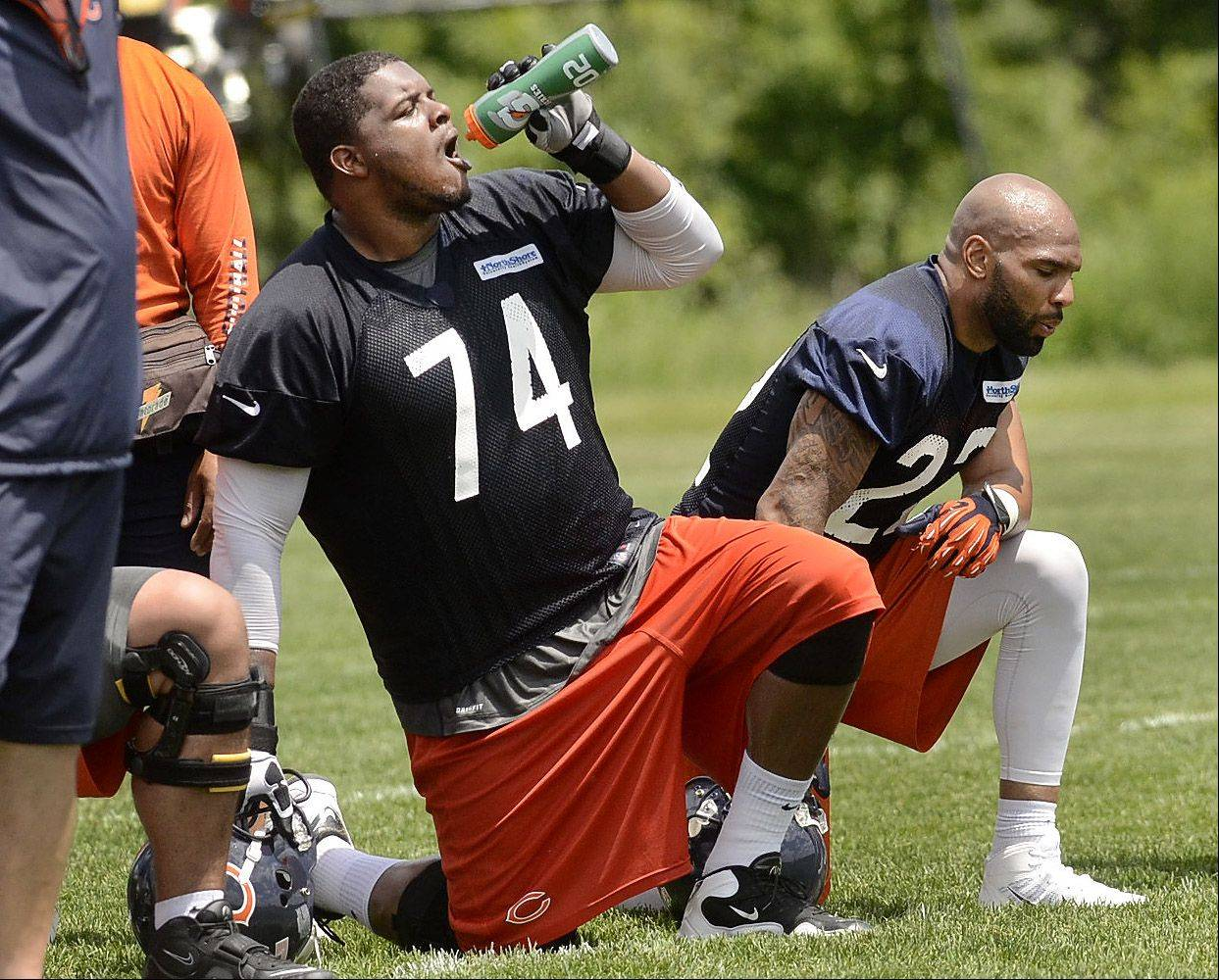 Bob Chwedyk/bchwedyk@dailyherald.com Left tackle Jermon Bushrod, at left kneeling alongside running back Matt Forte, is nursing a calf injury. But he hopes to play in Friday�s preseason opener at Carolina.