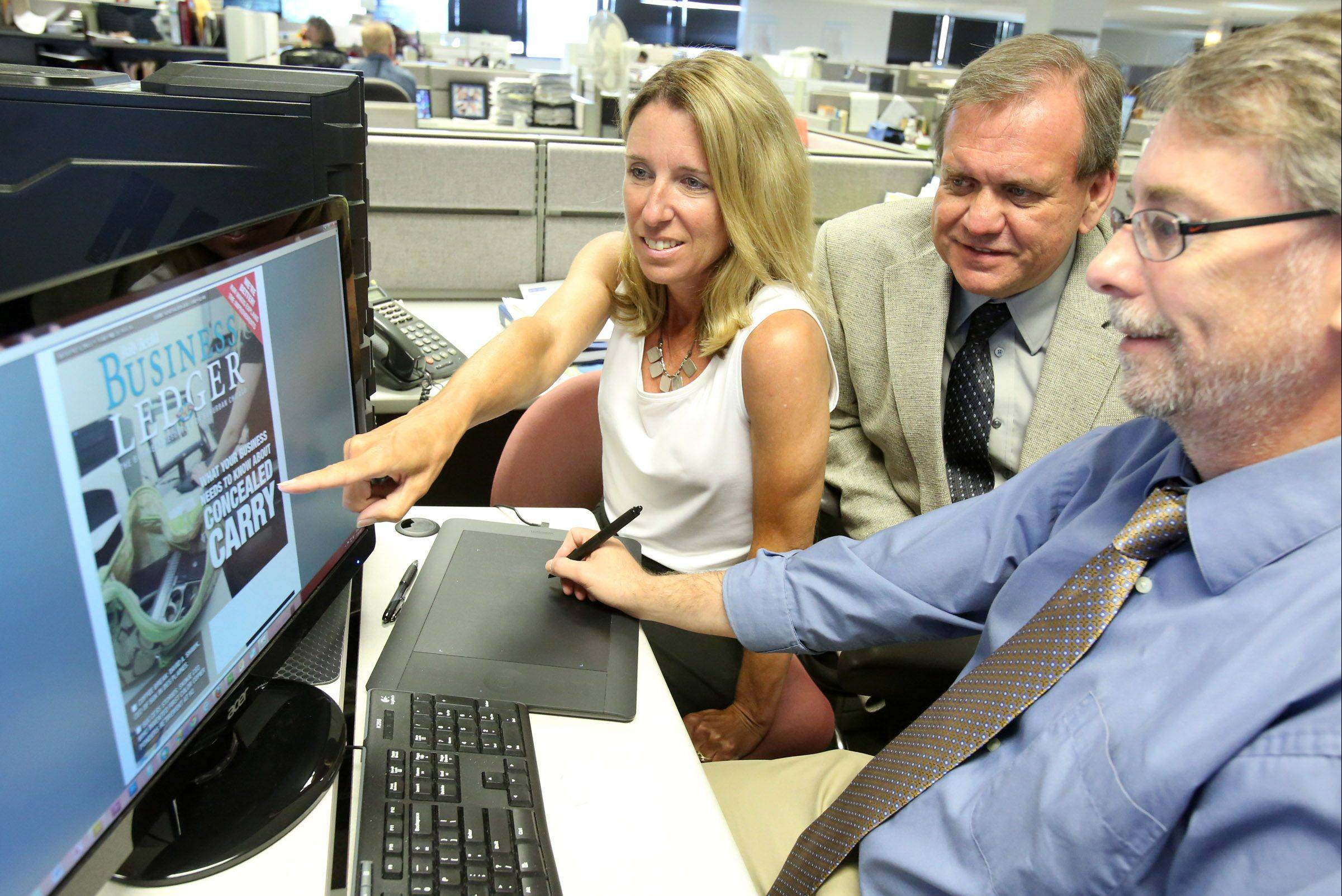 Daily Herald Business Ledger Editor Kim Mikus, left, Director of Content Development Richard R. Klicki and News Presentation Editor Tim Broderick work on a recent edition of the Business Ledger.
