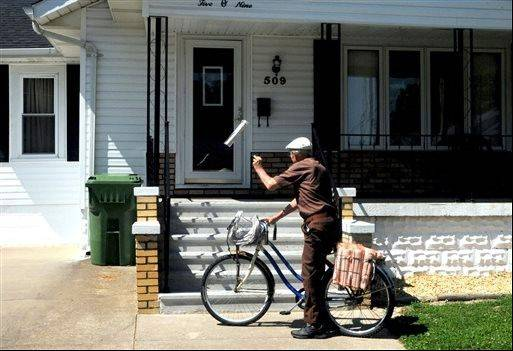Marvin Teel delivers the five-day a week Benton Evening News in Christopher. Teel turned 90 on July 23 and still delivers newspapers five days a week on his bike.