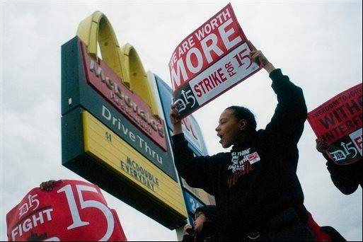 Associated Press  Fast-food worker Michelle Osborn, 23, of Flint shouts out chants as she and a few dozen others strike outside of McDonald's on Wednesday in Flint.