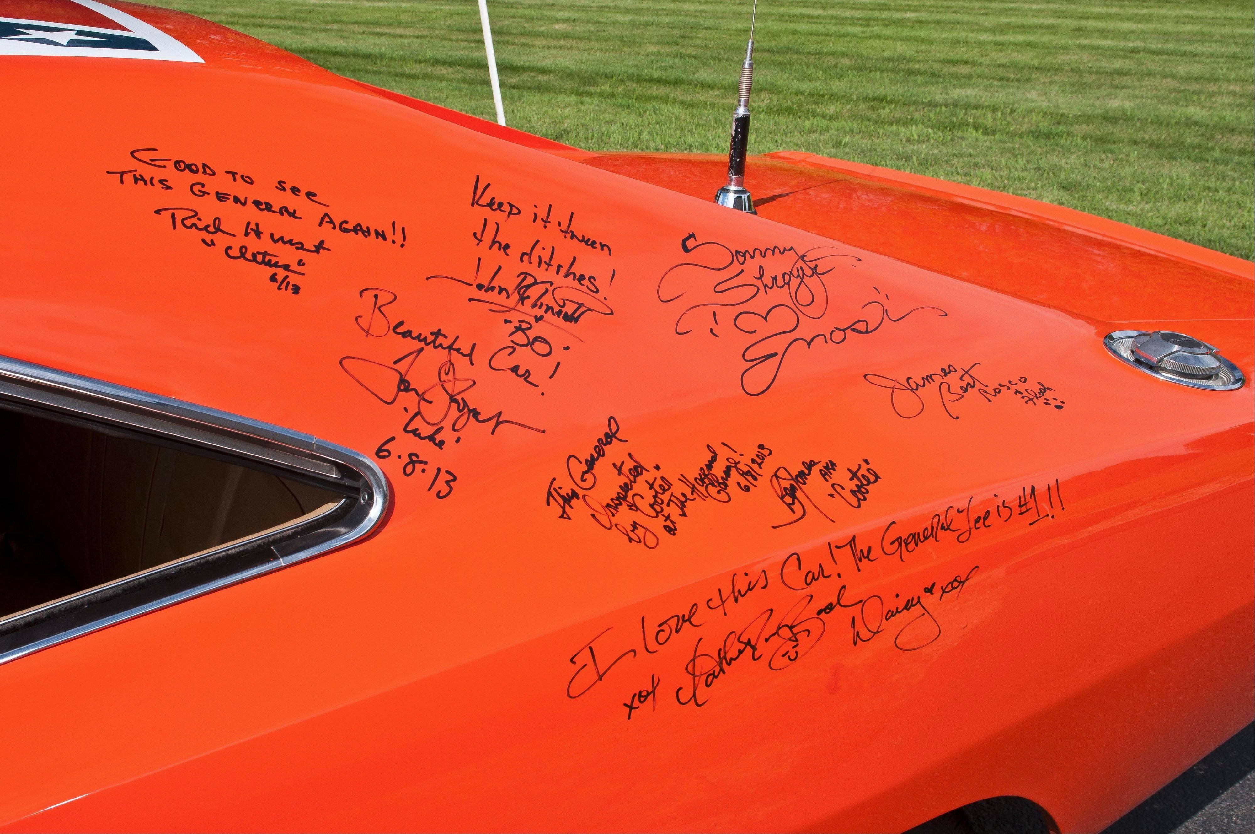 The surviving cast members appeared at a recent fan convention in Nashville, Tenn., and signed the Charger.