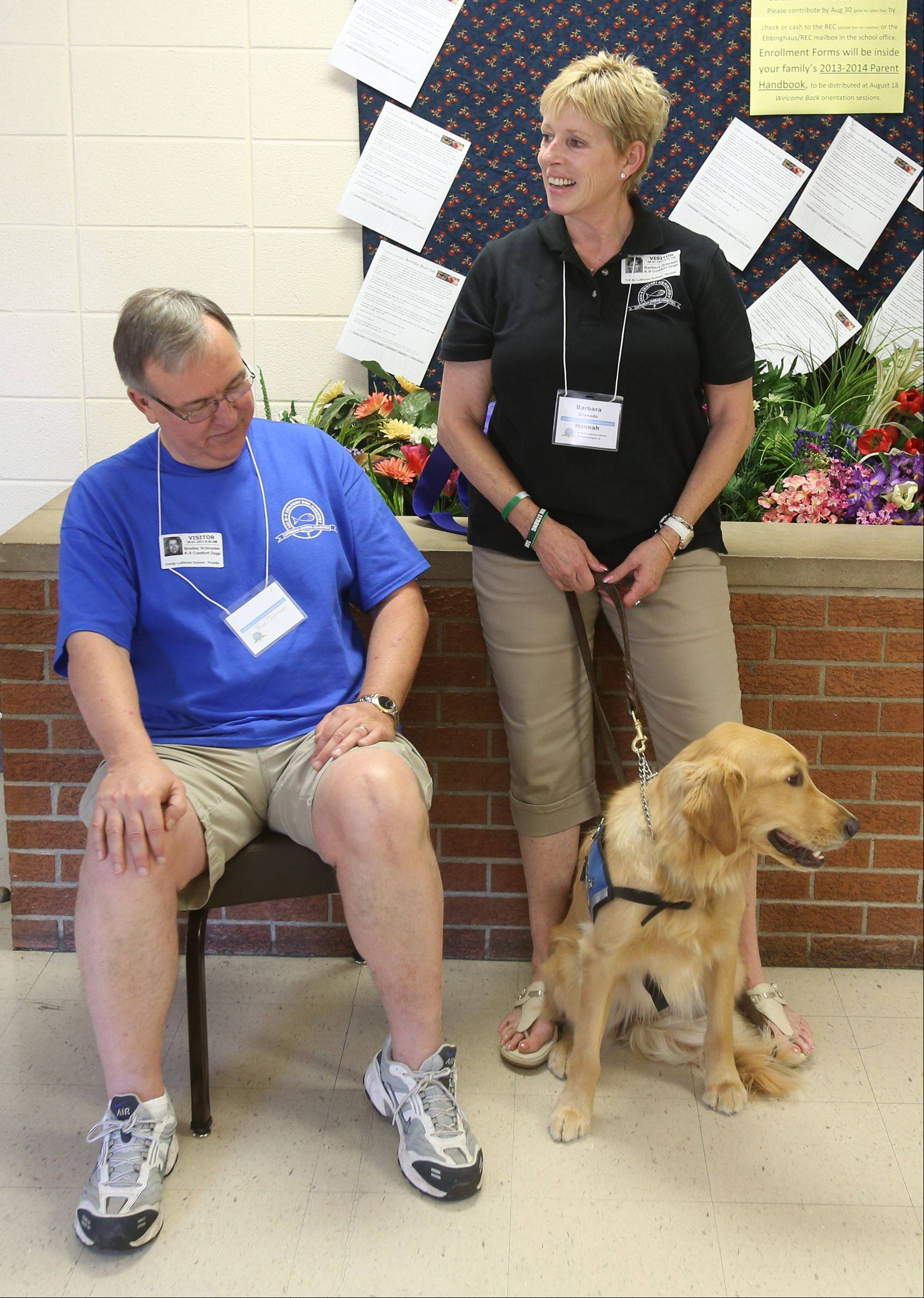 Bradley Schroeder and Barbara Granado, of Arlington Heights, along with comfort dog Hannah, relax as other comfort dogs participate in the annual meeting for the K-9 Comfort Dog Ministry held this year at the Trinity Lutheran Church in Roselle.