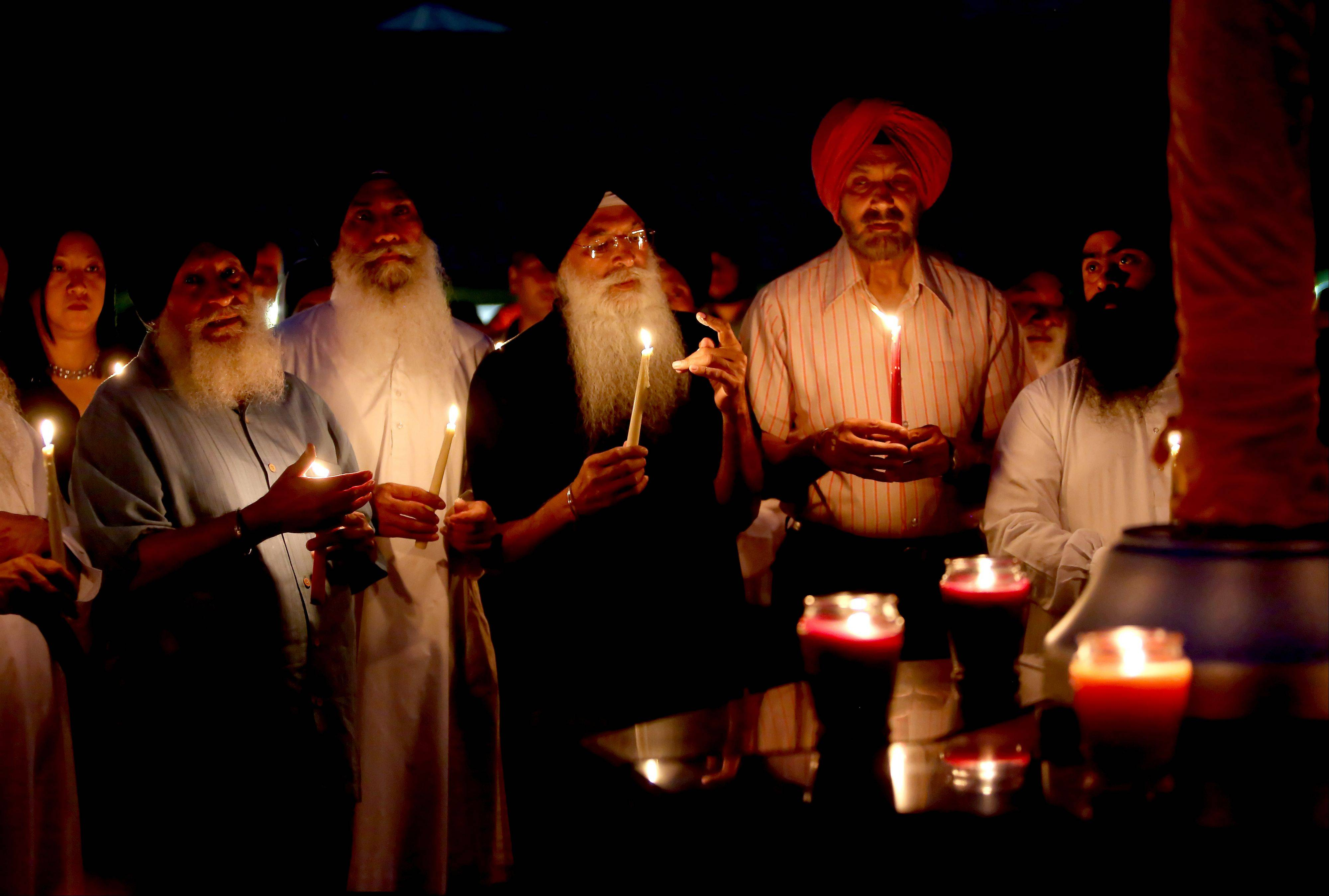 A candlelight vigil in Palatine on Monday night commemorated the victims of a shooting a year ago at a Sikh temple near Milwaukee.