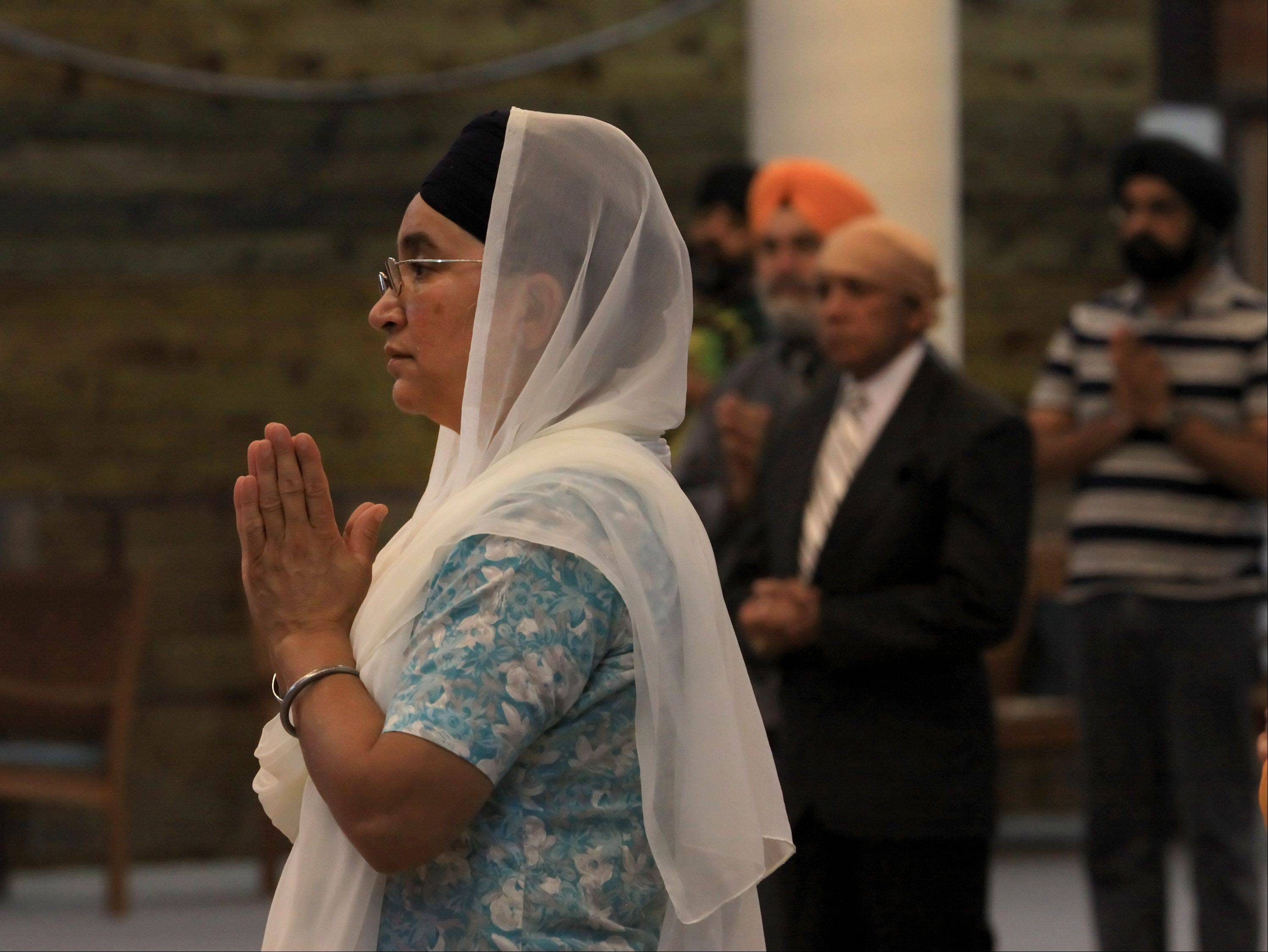 Paramjeet Kauer of Chicago prays during a service Monday at the gurdwara in Palatine.