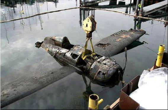 The World War II era FM-2 Wildcat is pulled out of the water at Larsen Marine in Waukegan last December.