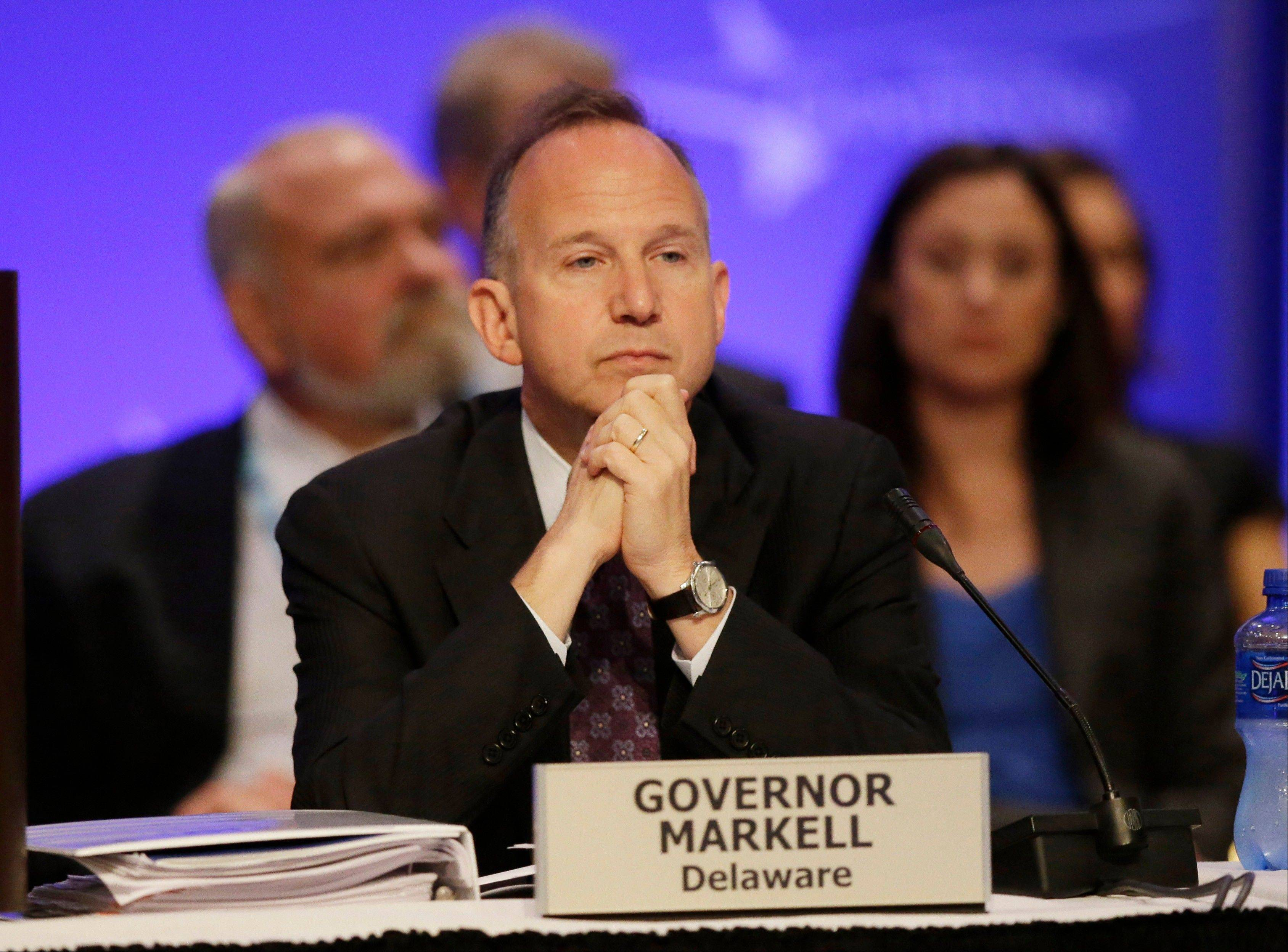 Delaware Gov. Jack Markell listens during a session of the National Governors Association meeting Sunday, Aug. 4, 2013 in Milwaukee. Democratic governors say they are nervous about getting the new federal health care law implemented but add they will be better positioned in next year's elections than many of their Republican counterparts who have resisted the far-reaching and politically polarizing measure.