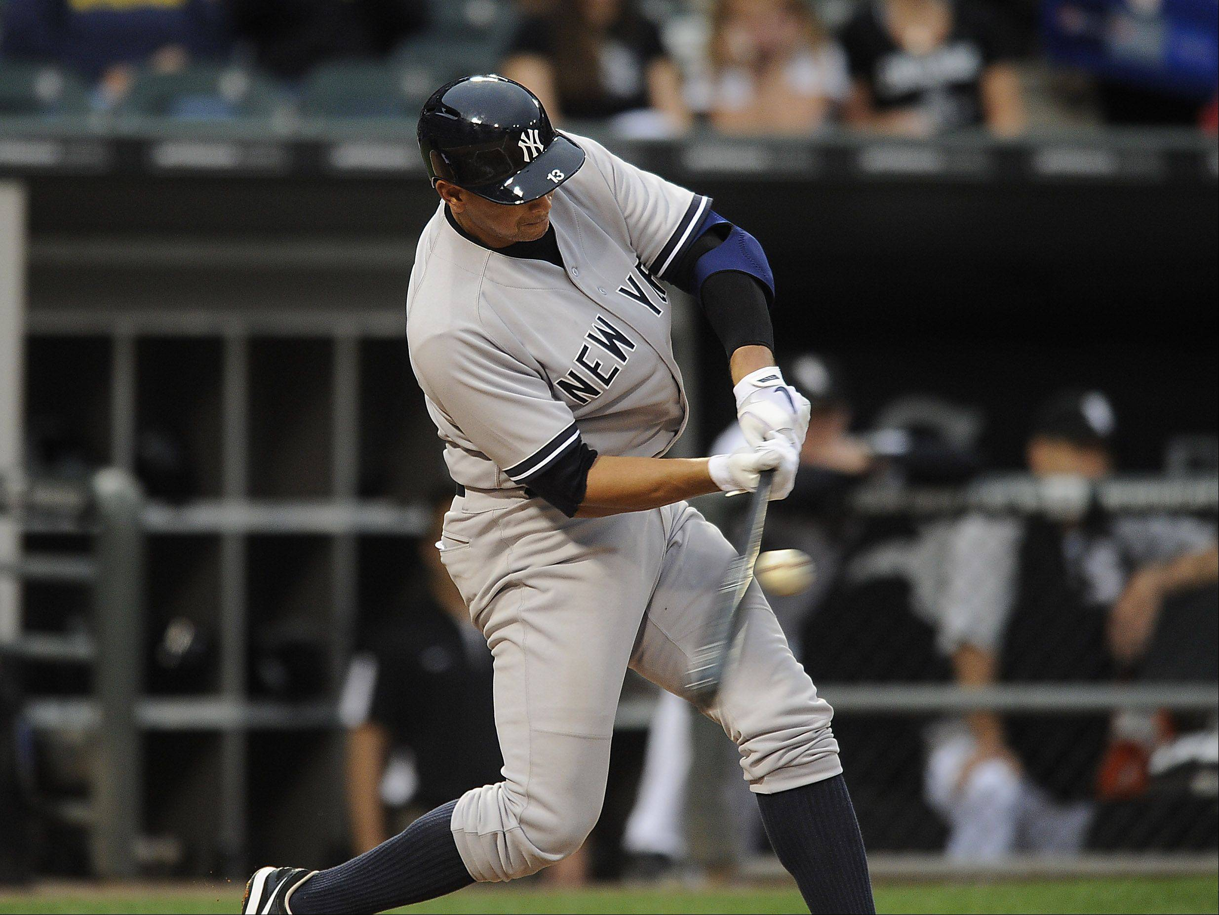 New York Yankees Alex Rodriguez hits a single leading off in the second inning at Cellular Field in Chicago on Monday.