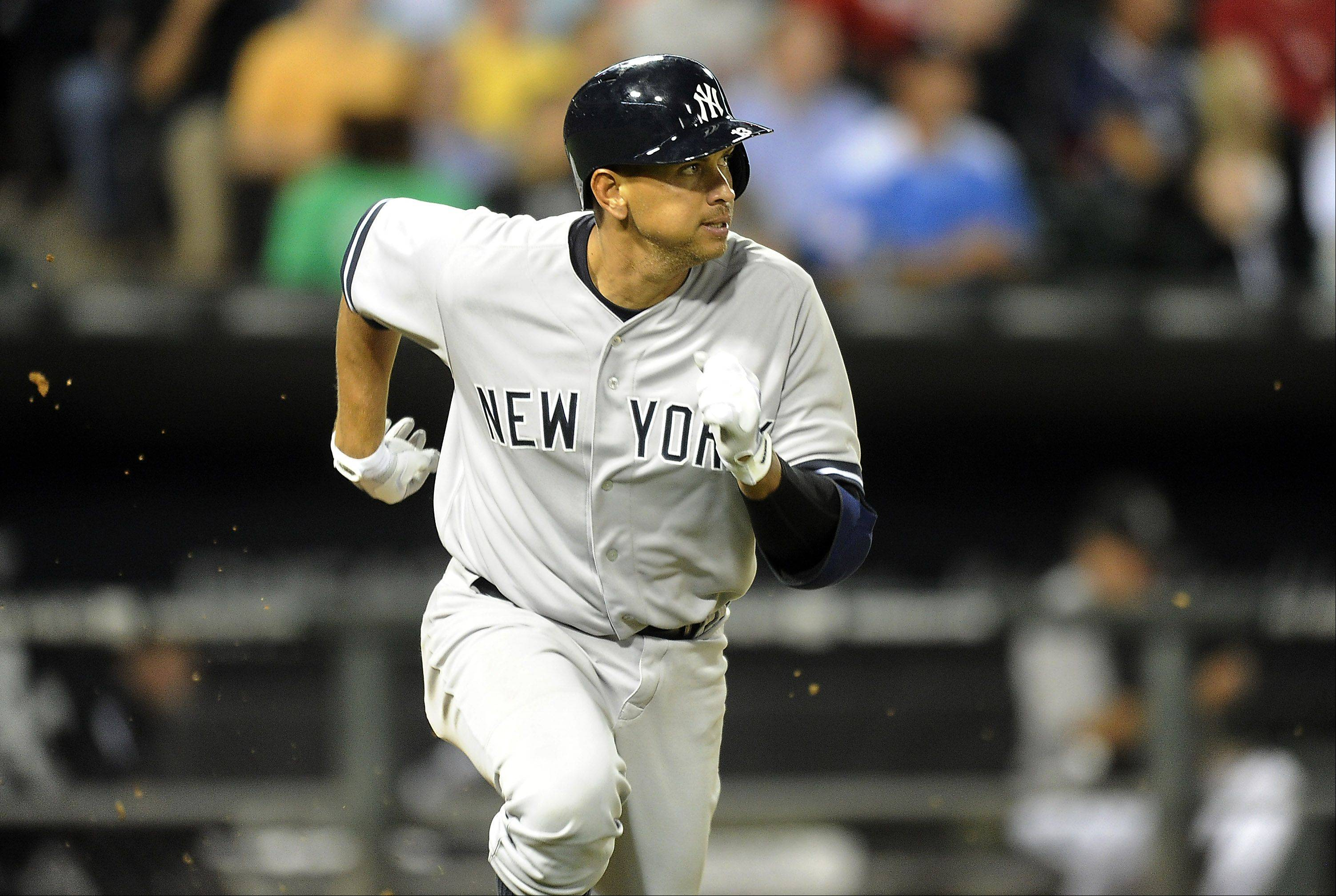 New York Yankees Alex Rodriguez eyes his fly ball hit to center field as he runs to first base which was caught in the fourth inning at Cellular Field in Chicago on Monday.