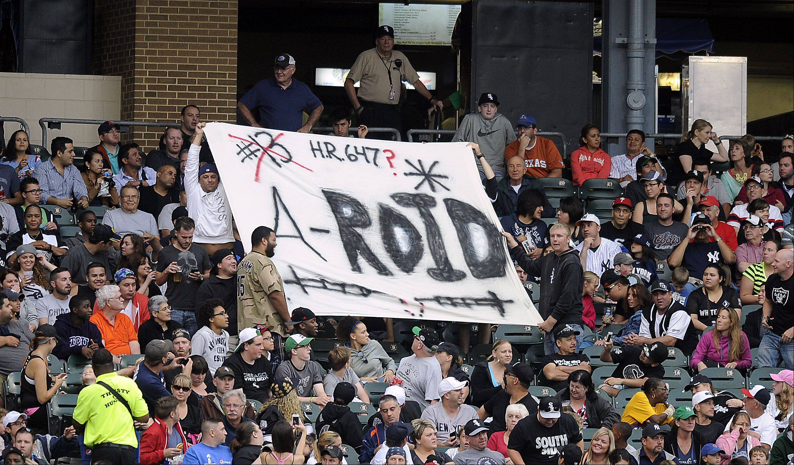 Fans express their feelings toward New York Yankees Alex Rodriguez at Cellular Field in Chicago on Monday.
