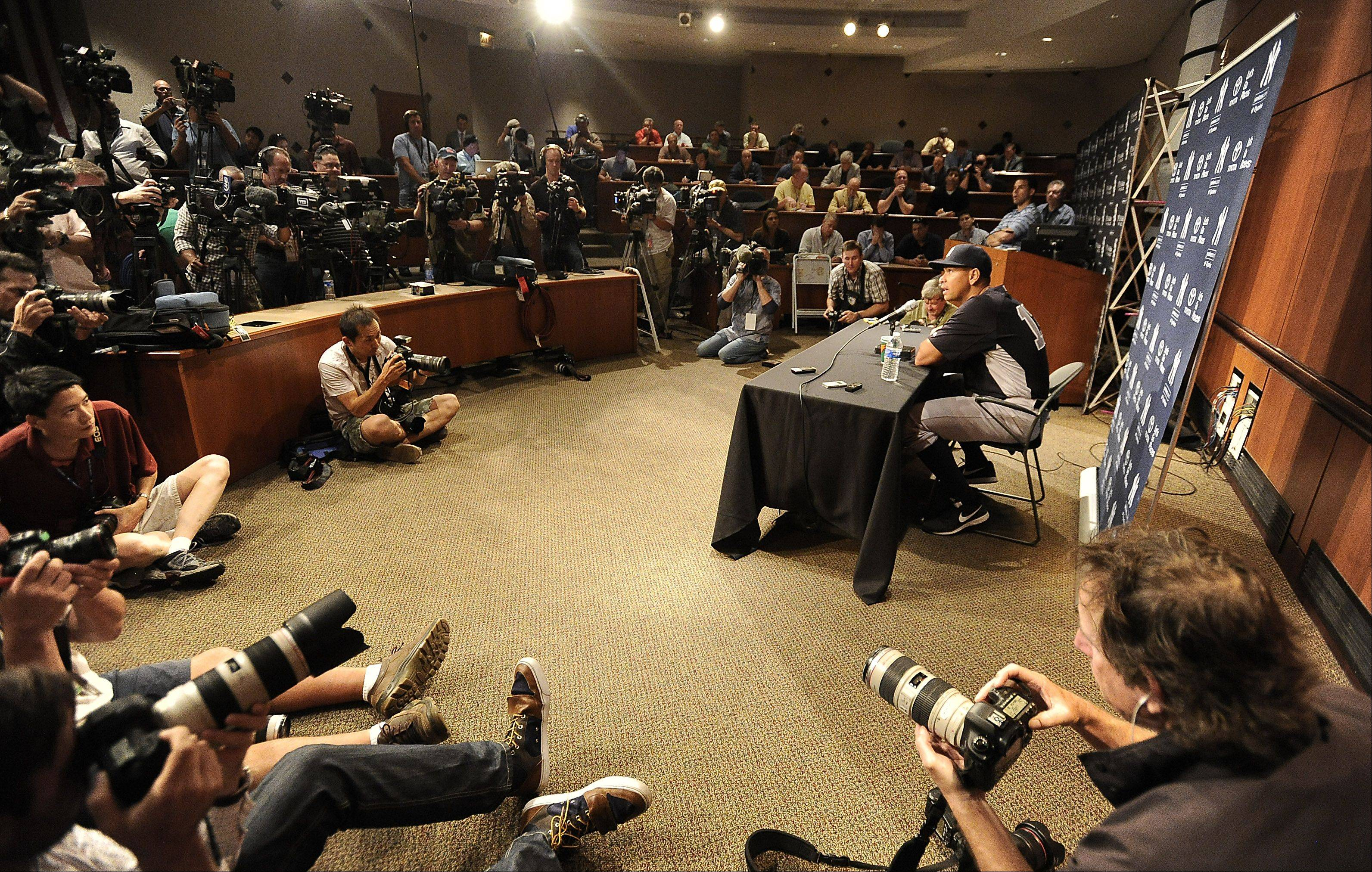 New York Yankees Alex Rodriguez answers questions from the media at Cellular Field in Chicago on Monday.