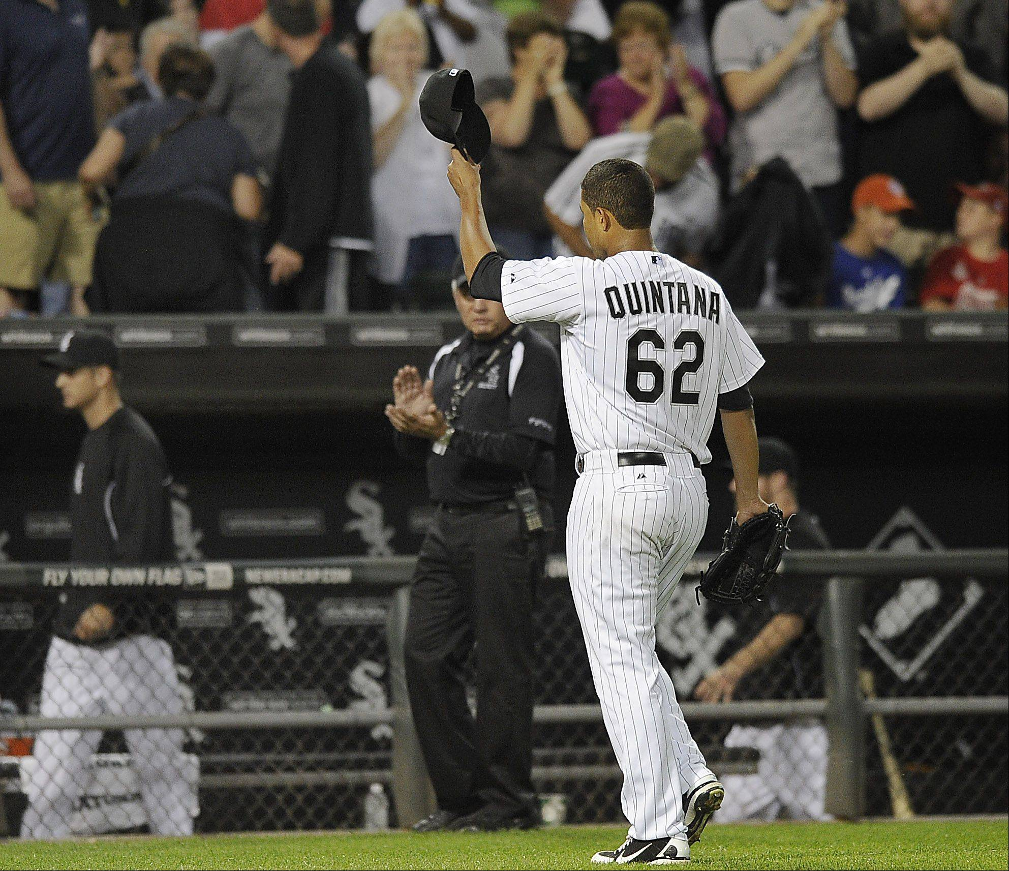 White Sox's Jose Quintana, pitcher tips his hat to the audience at Cellular Field in Chicago on Monday.