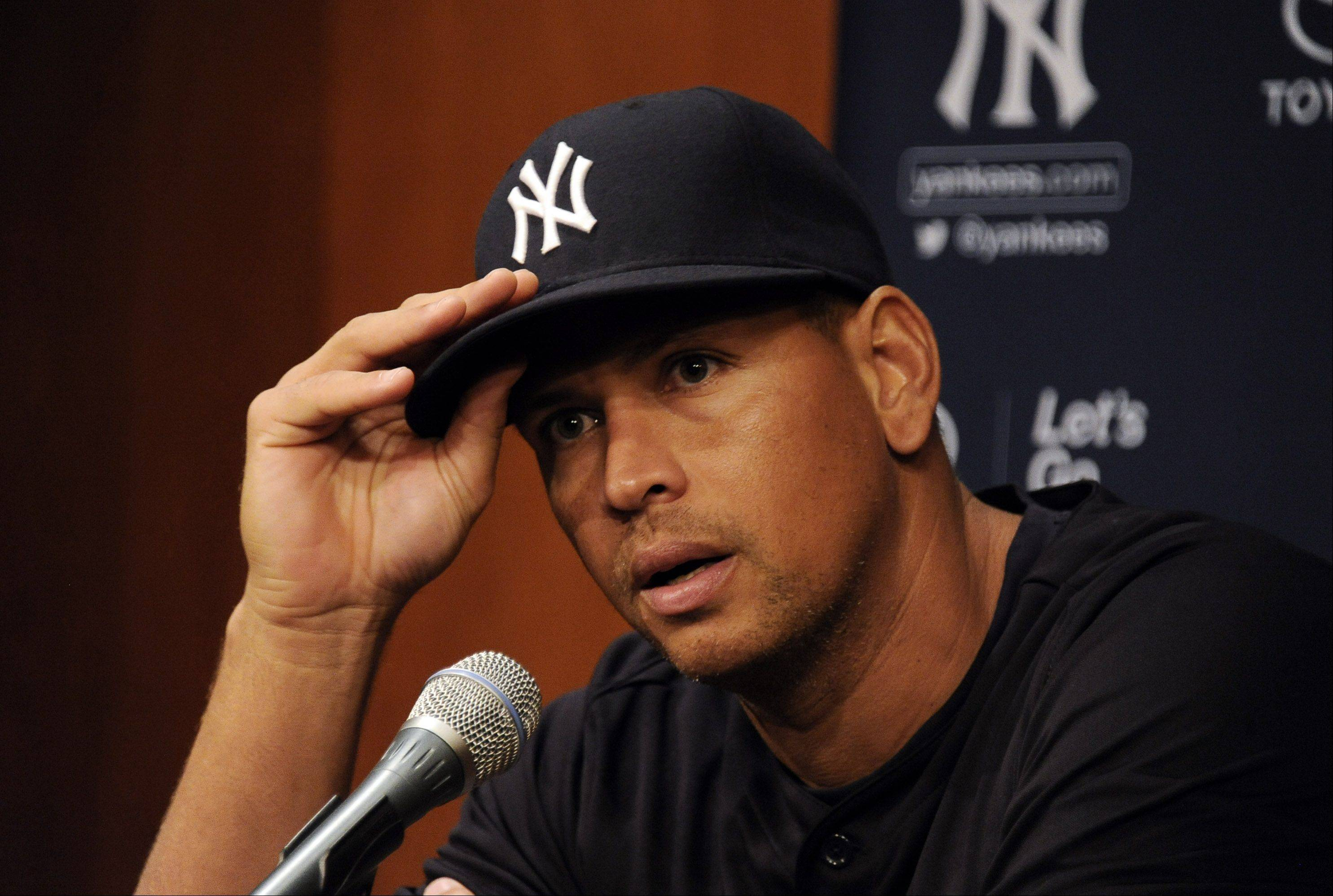 New York Yankees Alex Rodriguez answers tough questions from the media at Cellular Field in Chicago on Monday.