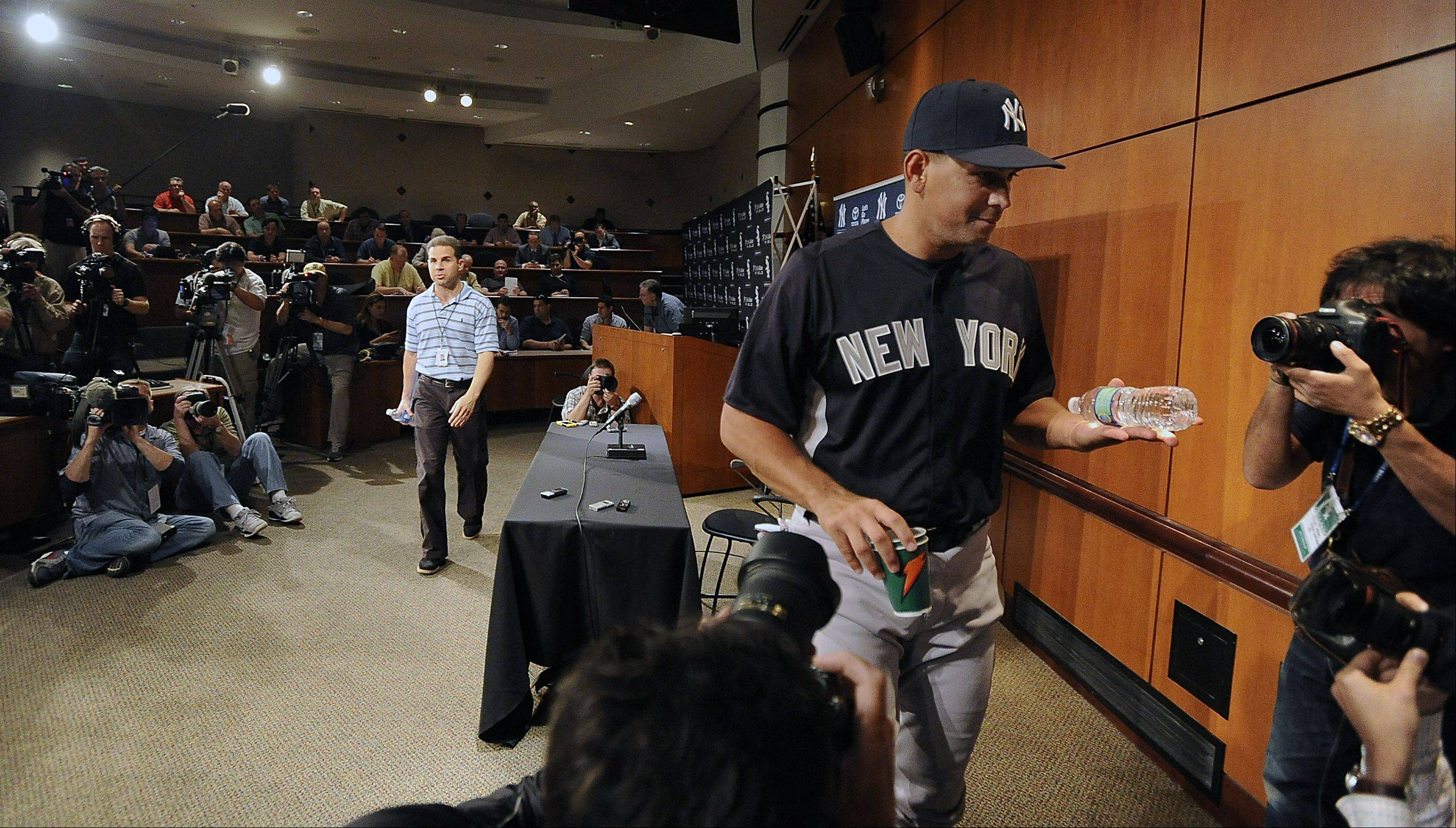 New York Yankees Alex Rodriguez answers questions from the media then leaves for the game against the Chicago White Sox at Cellular Field in Chicago on Monday.