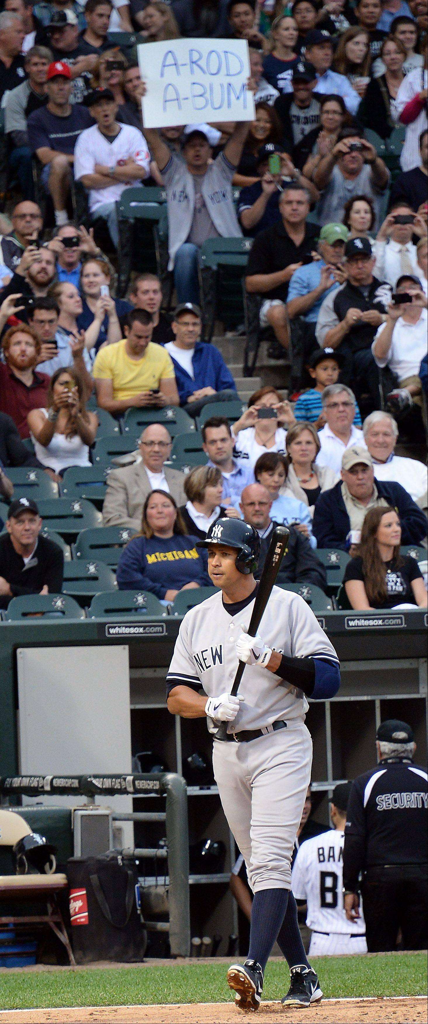 New York Yankees Alex Rodriguez bats during the first inning at Cellular Field in Chicago on Monday as fans express their feelings toward him.