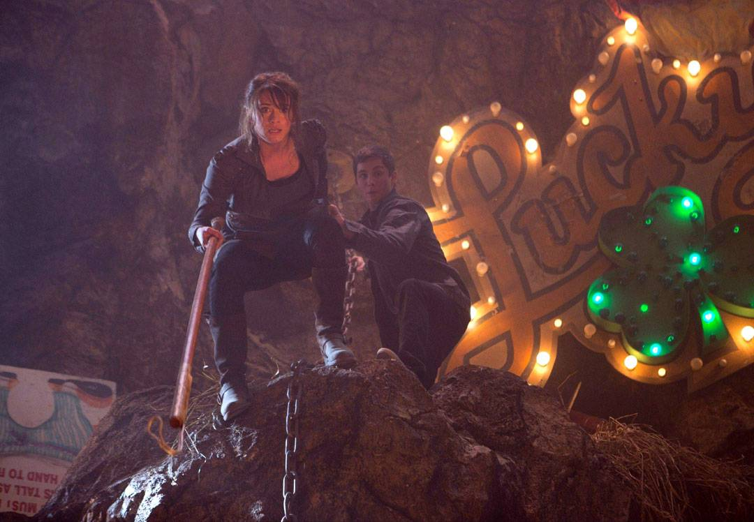 "Clarisse (Leven Rambin) and Percy (Logan Lerman) navigate a dangerous amusement park in ""Percy Jackson: Sea of Monsters."""