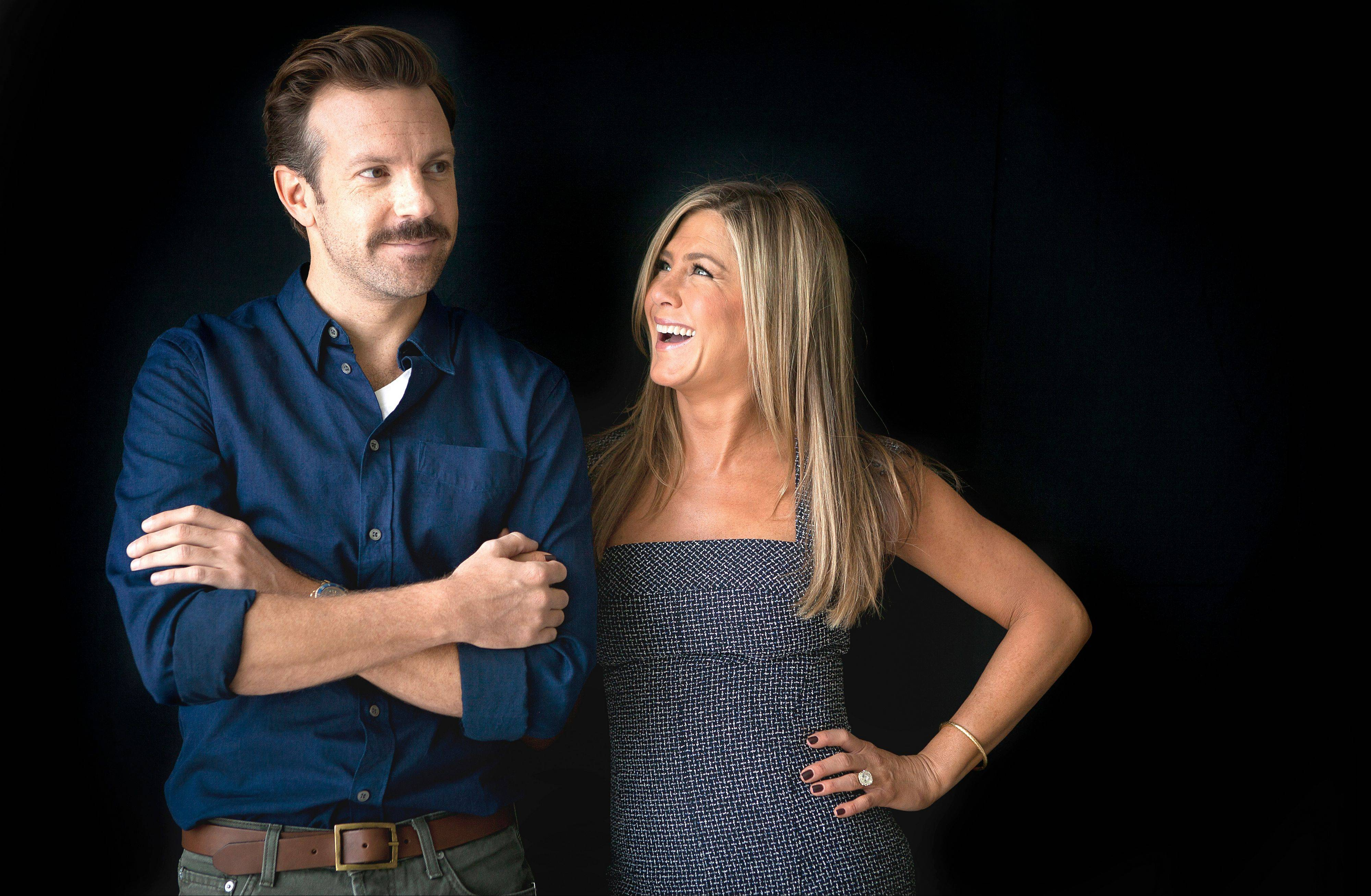 Actor Jason Sudeikis, left, and actress Jennifer Aniston star in the new comedy �We�re the Millers.�