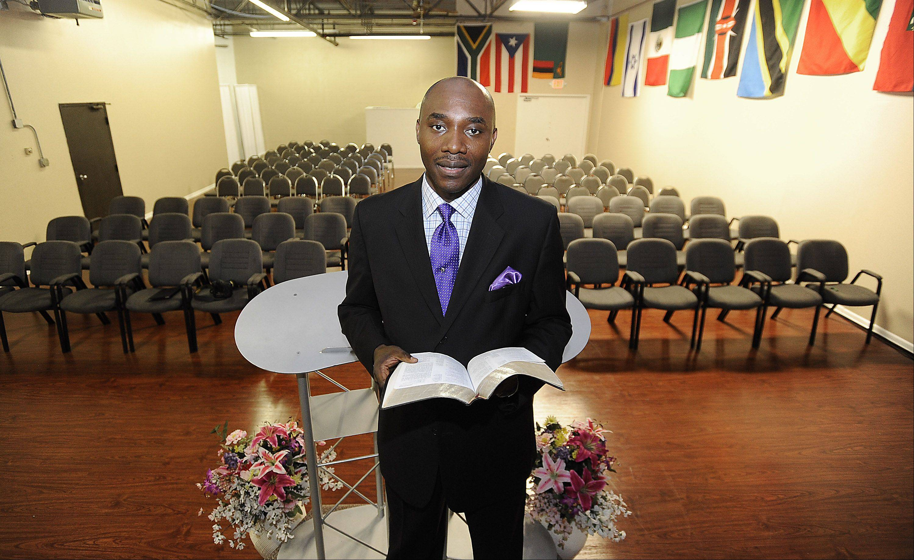Senior Pastor Joe Kamanda of Round Lake gets ready to celebrate Glory House�s 10th anniversary with a ribbon cutting and service this Friday after moving into a building in Prospect Heights.