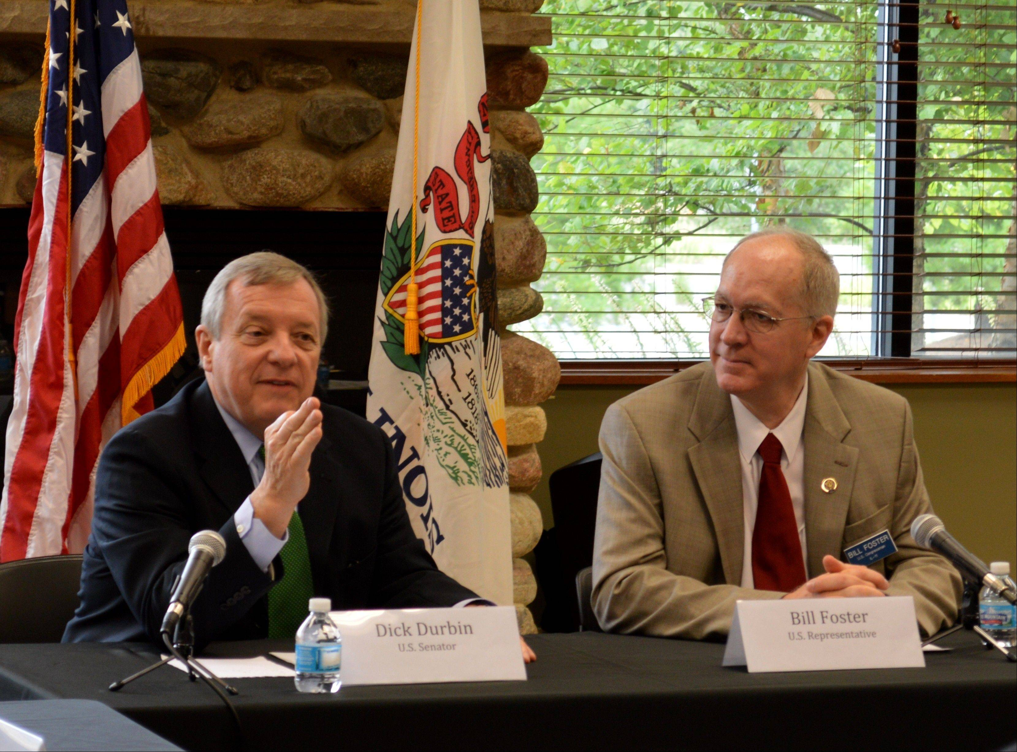 Sen. Dick Durbin, left, and Rep. Bill Foster joined forces in Aurora Tuesday to challenge House Republicans to bring a Senate immigration reform proposal to a vote.
