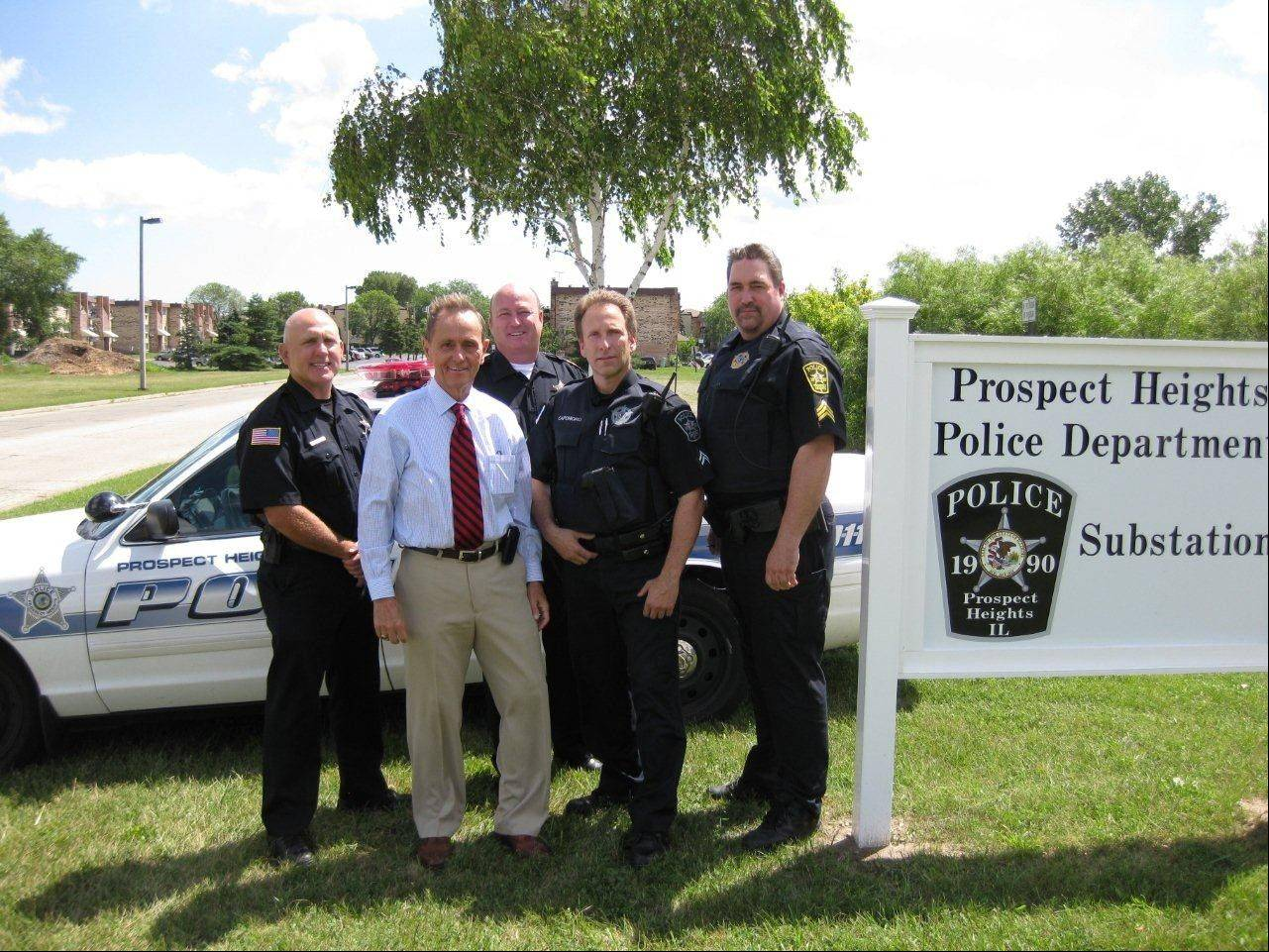 Prospect Heights officials announce the opening of a police substation in the eastern part of the city. From left: Deputy Chief Al Steffen, Mayor Nick Helmer, Chief Jamie Dunne, Cpl. Bill Caponigro and Sgt. Joe Pawlicki.