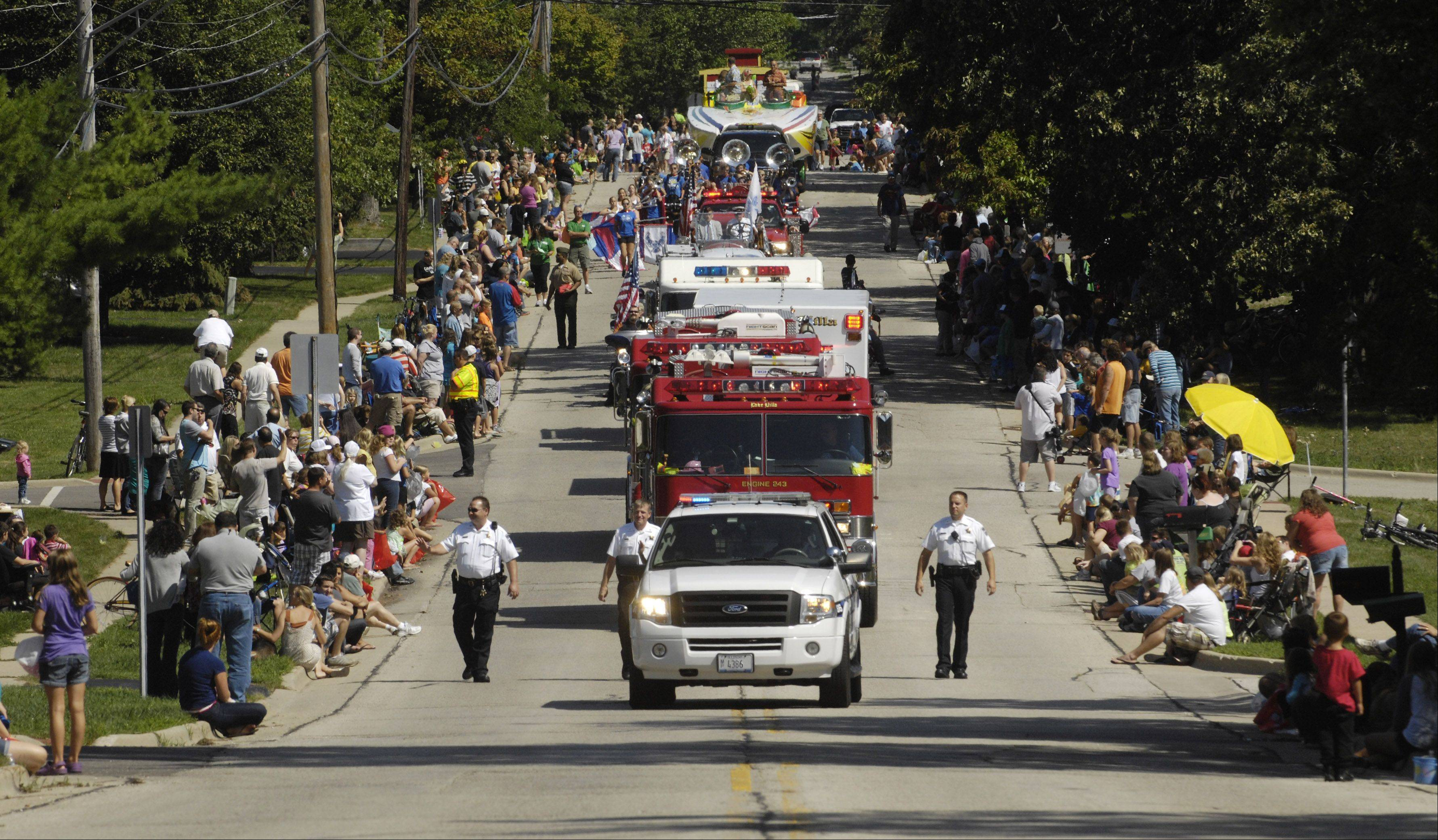 Emergency vehicles lead last year's Lindenfest parade on Beck Road in Lindenhurst.
