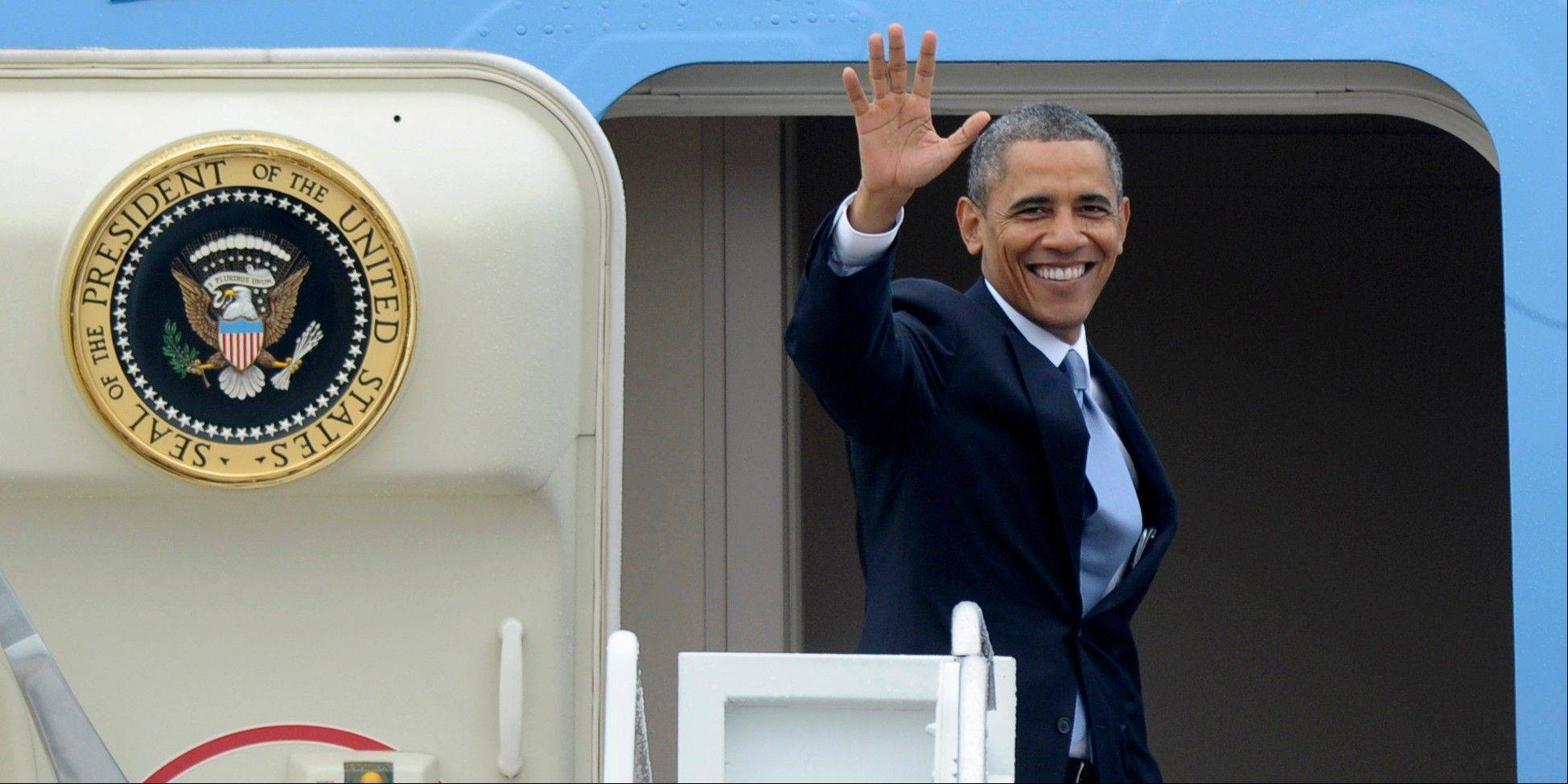 President Barack Obama waves from the top of the steps of Air Force One at Andrews Air Force Base Md., Tuesday, Aug. 6, 2013. Obama is traveling to Arizona and California.