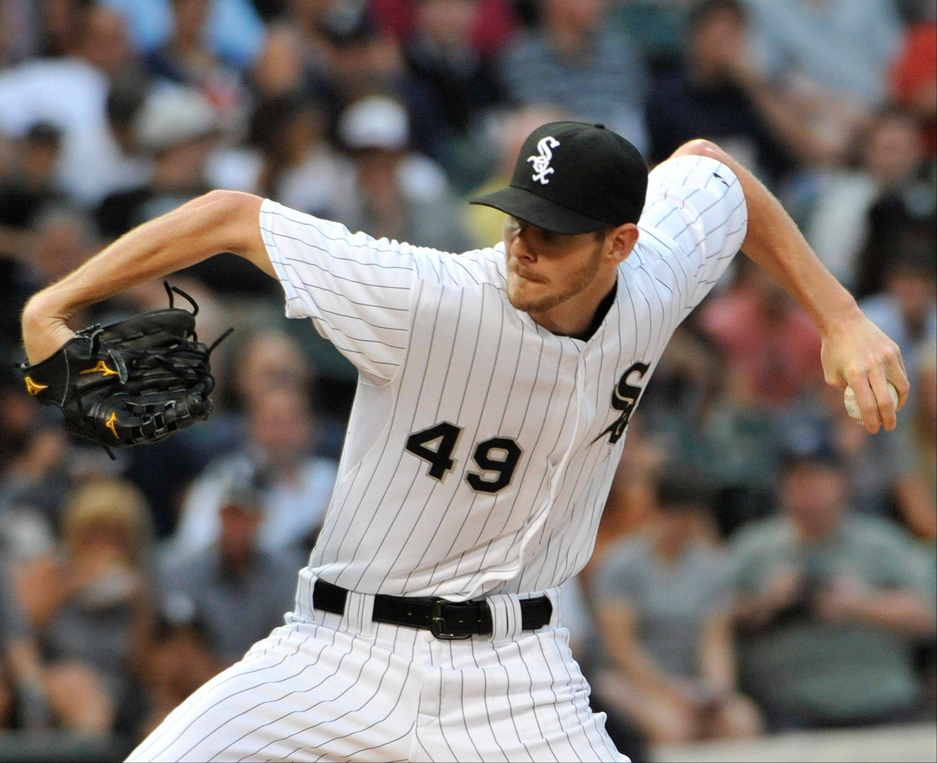 Chicago White Sox' Chris Sale pitches against the New York Yankees during the first inning of a baseball game, Tuesday, Aug. 6, 2013 in Chicago. (AP Photo/David Banks)