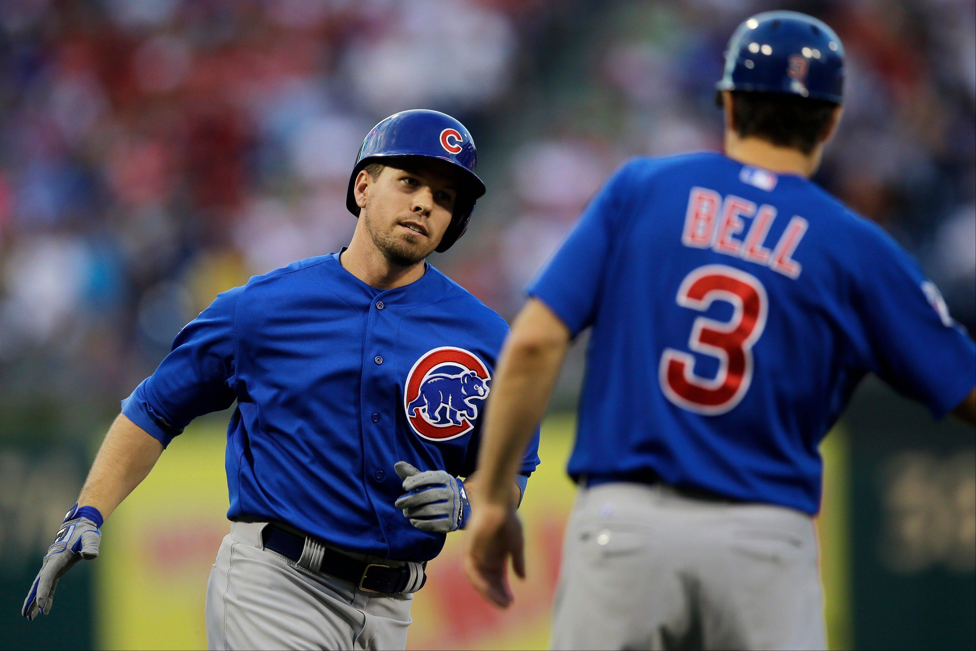 Chicago Cubs' Donnie Murphy, left, celebrates with third base coach David Bell as he rounds the bases after hitting a three-run home run off Philadelphia Phillies starting pitcher Kyle Kendrick in the second inning of a baseball game, Tuesday, Aug. 6, 2013, in Philadelphia. (AP Photo/Matt Slocum)