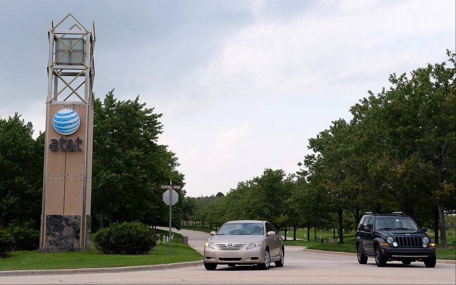 AT&T employees leave the work campus in Hoffman Estates on the news that 3,000 jobs will move to Chicago.