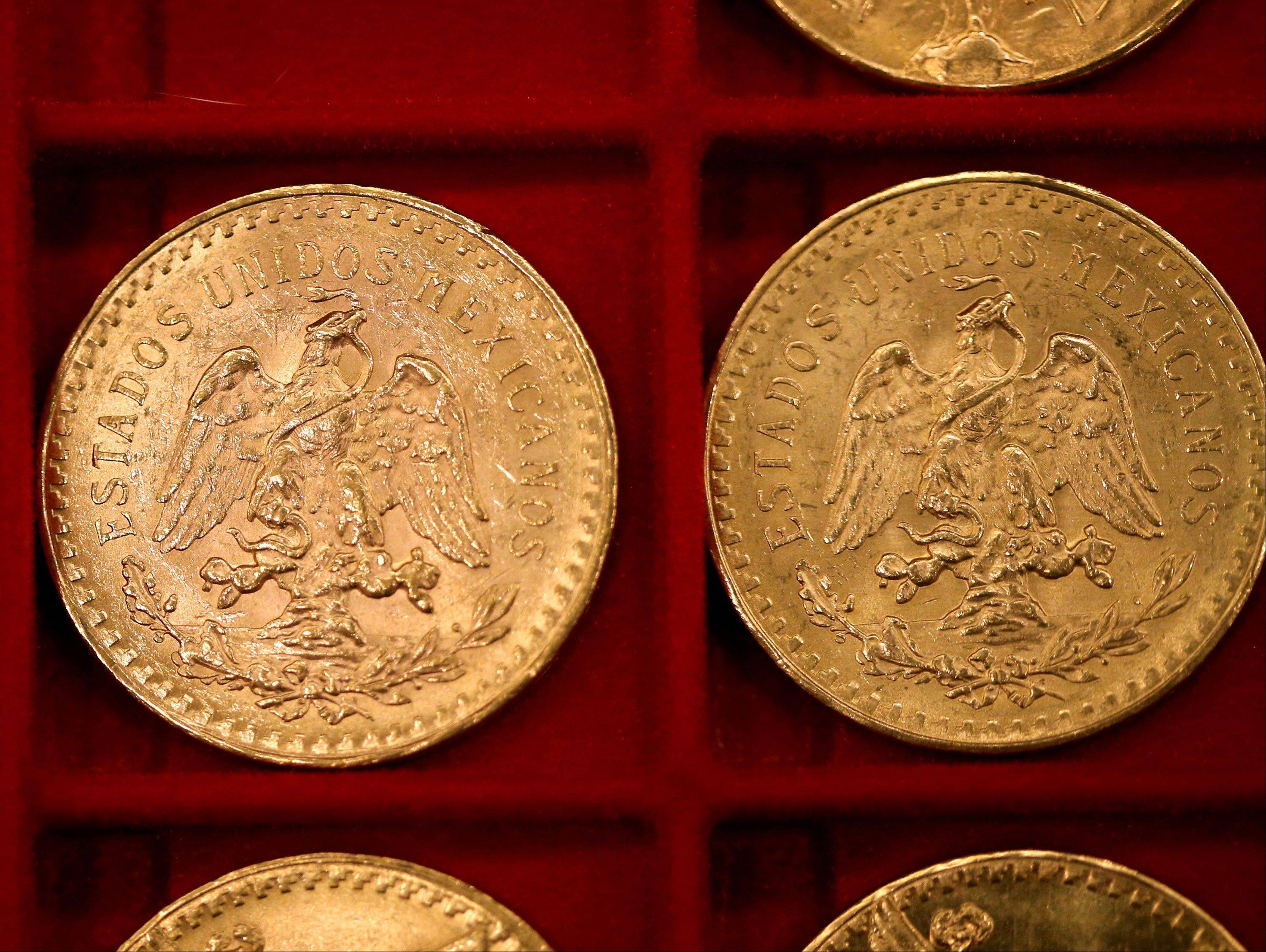 Gold Mexican 50-peso pieces that once belonged to Walter Samaszko, Jr. that were up for auction in Carson City, Nev. Samaszko, 69, died in June, 2012, leaving thousands of gold coins and bouillon in his garage.